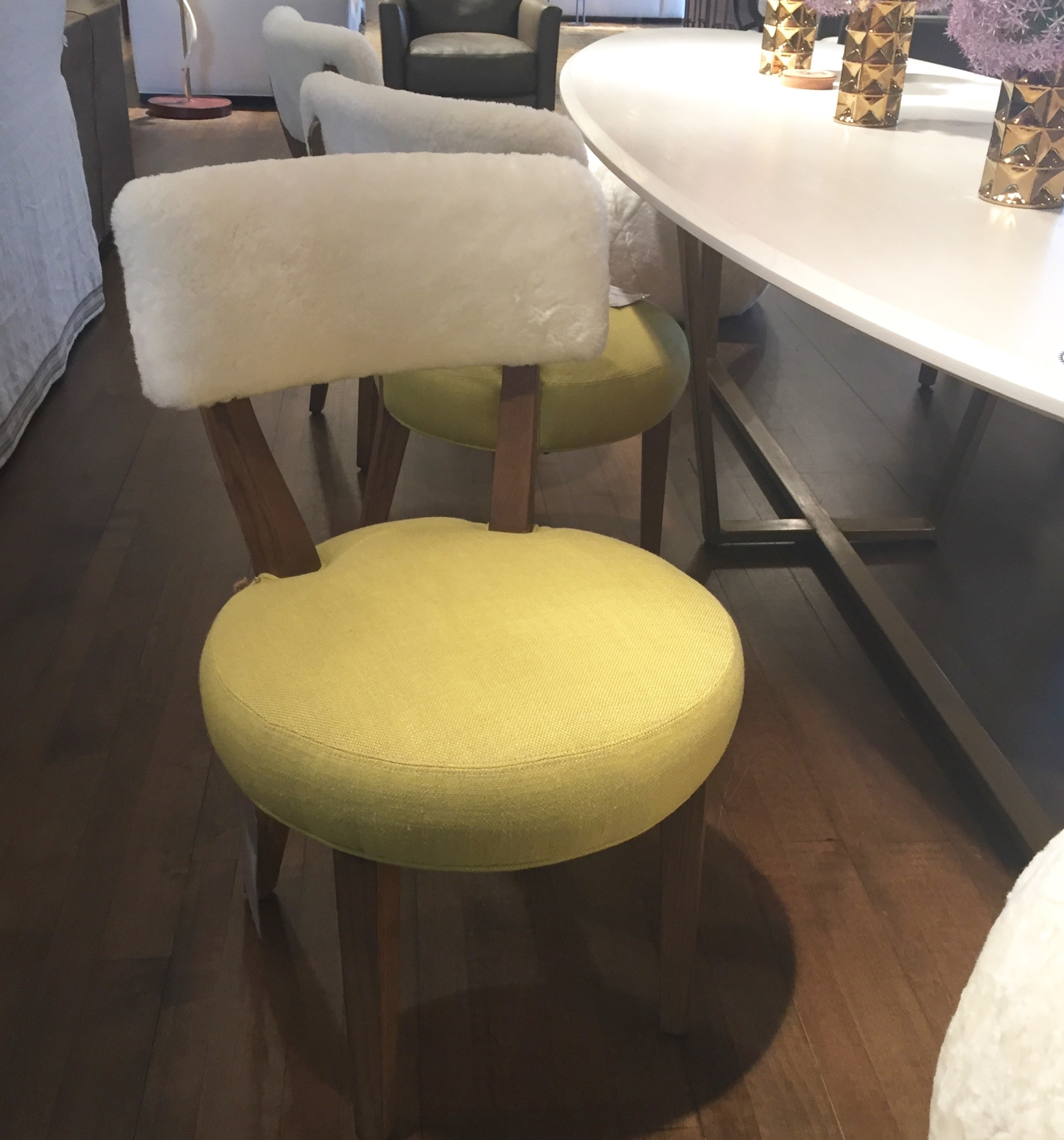 Dining chairs at Lee Industries with flirty shearling backs for extra comfort during long dinner parties.