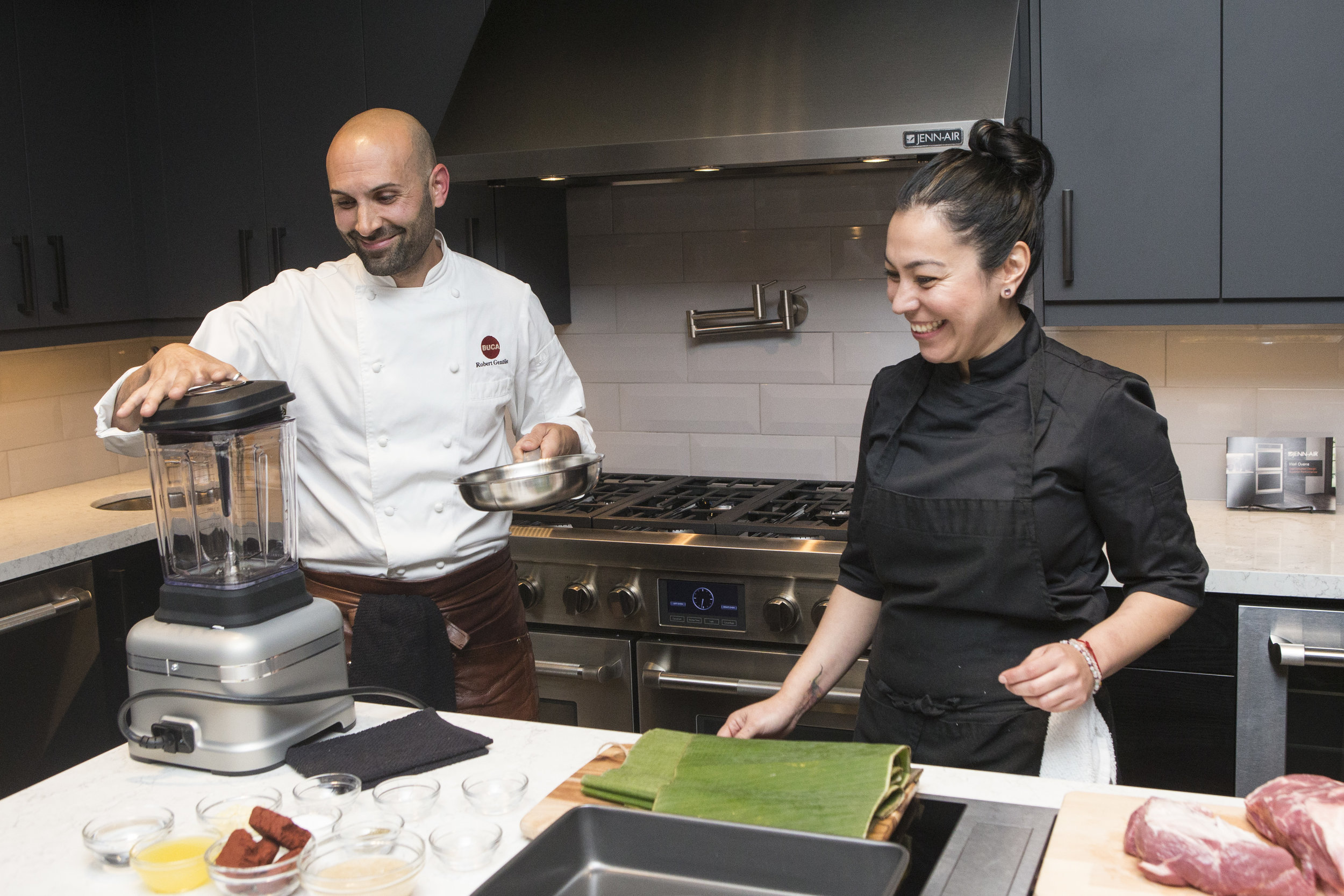 Chefs Rob Gentile and Elia Herrara start the evening with cooking demonstrations using state-of-the-art Jenn-Air appliances. photo: Chris Young