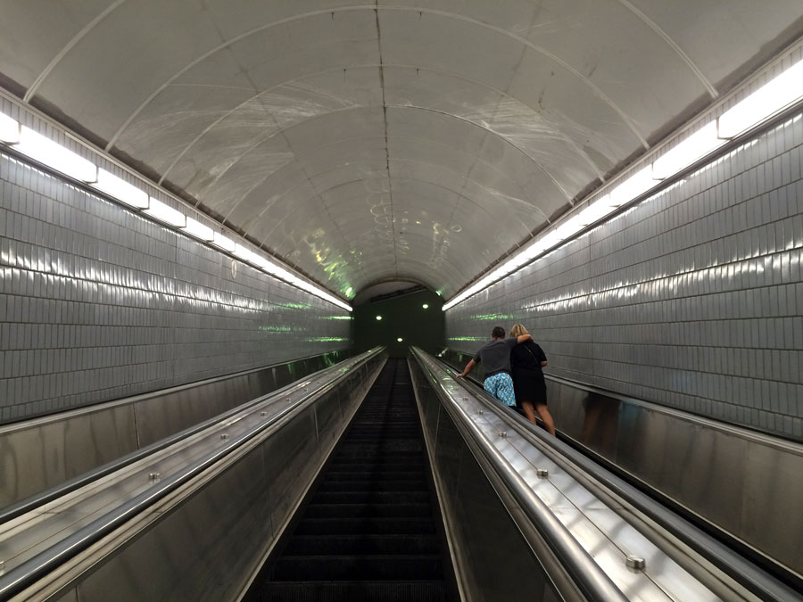 Don't look back.  Owners, Mike and Kerri Colangelo on the steepest, scariest, longest escalator ever encountered.