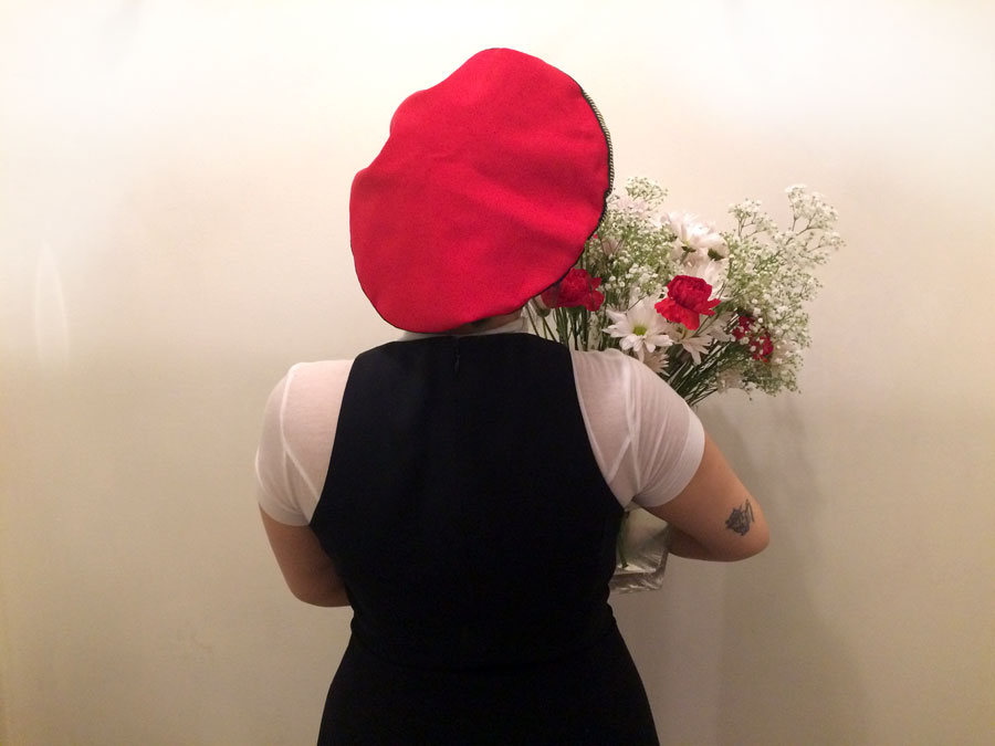 Join the Dechoes Red Berets Union.  Ivanna proudly holds her arrangement for  the daily IG shot (@dechoesresale) . She is wearing her own clothes and a red vintage beret with striped gold lamétrim from   Jean Charles Brosseau for Bergdorf Goodman .