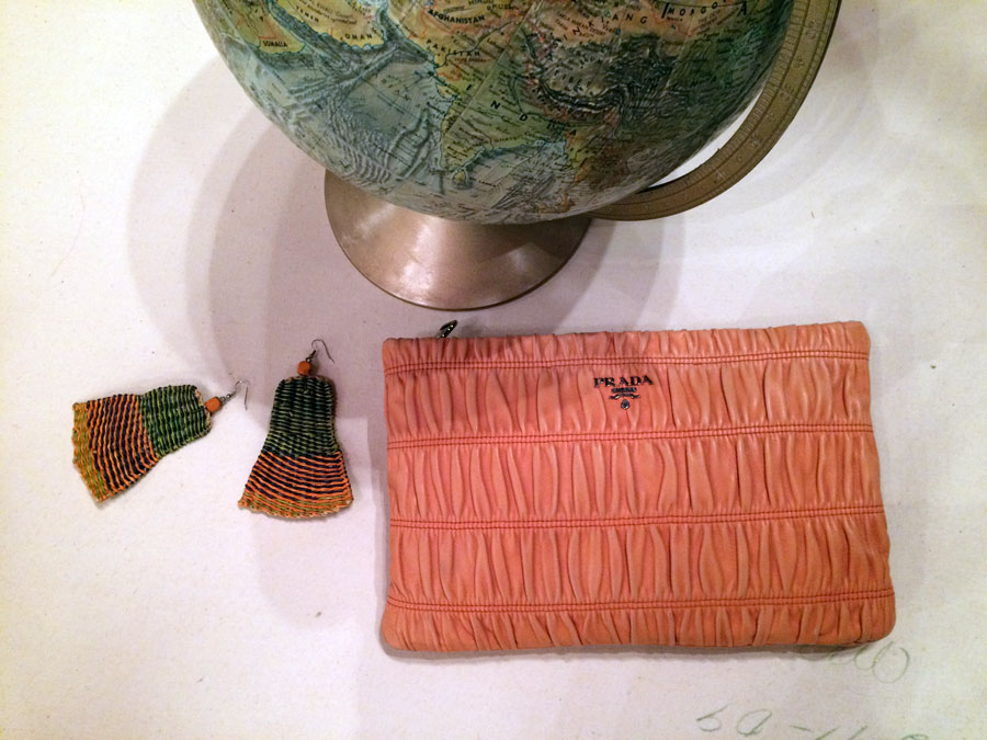 Tactile senses.  1. A full view of the world with relief details of the continents. Globe from  Replogle,World Ocean Series ( Cartographer: Le Roy M. Tolman ) 2. Handmade woven earrings in citrus colors. 3. Oversized ruched calfskin leather clutch in sherbet that speaks to the hands,  Prada .