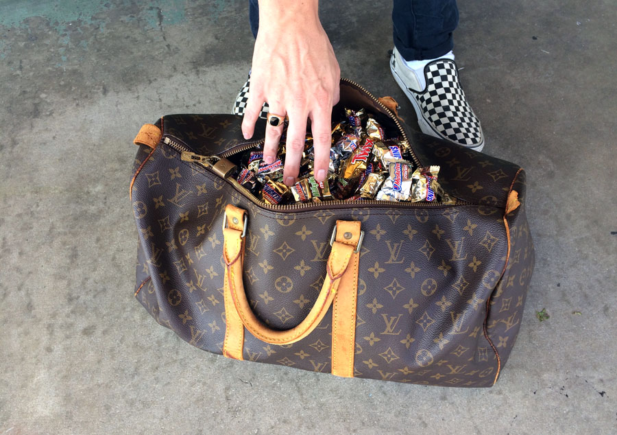 Luxurious Trick-or-Treat Bag.  Jon shows us how trick-or-treating is done at the shop.  Vintage Louis Vuitton Keepall 60 Bandouliere,  checkerboard Vans slip-ons.