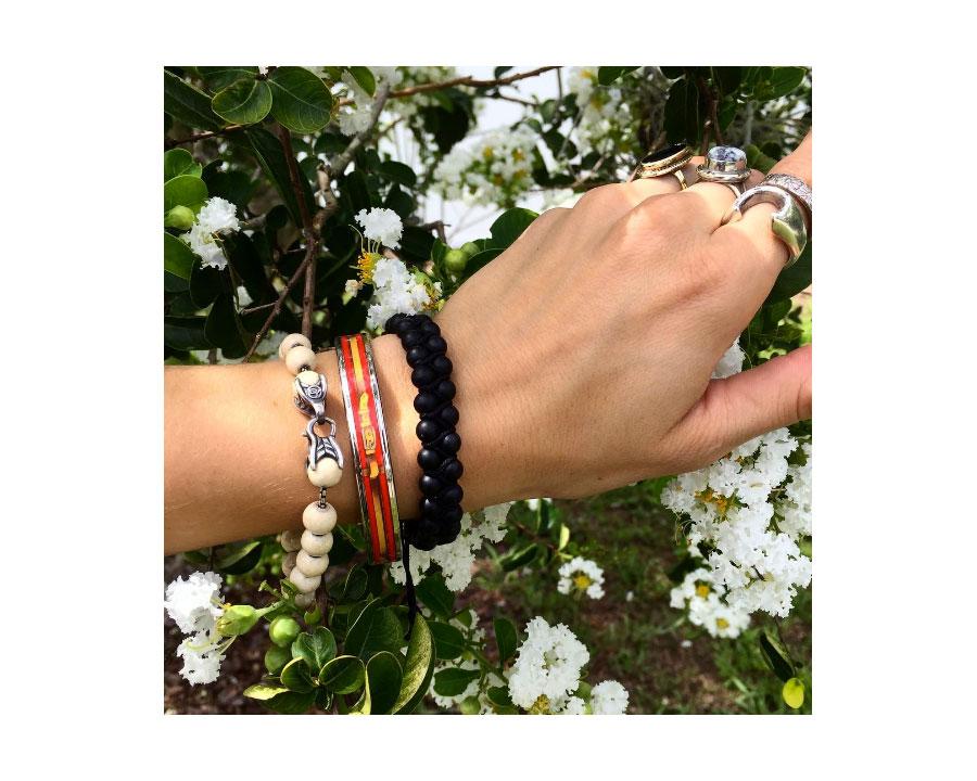 Beaded  David Yurman  bracelets. Printed enamel belt print metal bangle from  Hermes .