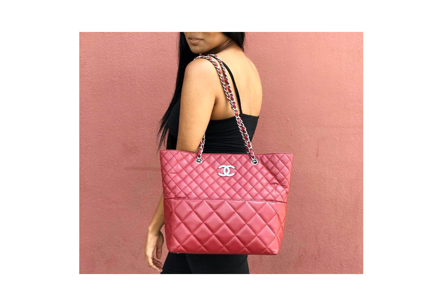 Quilted tote with signature chain strap in red.
