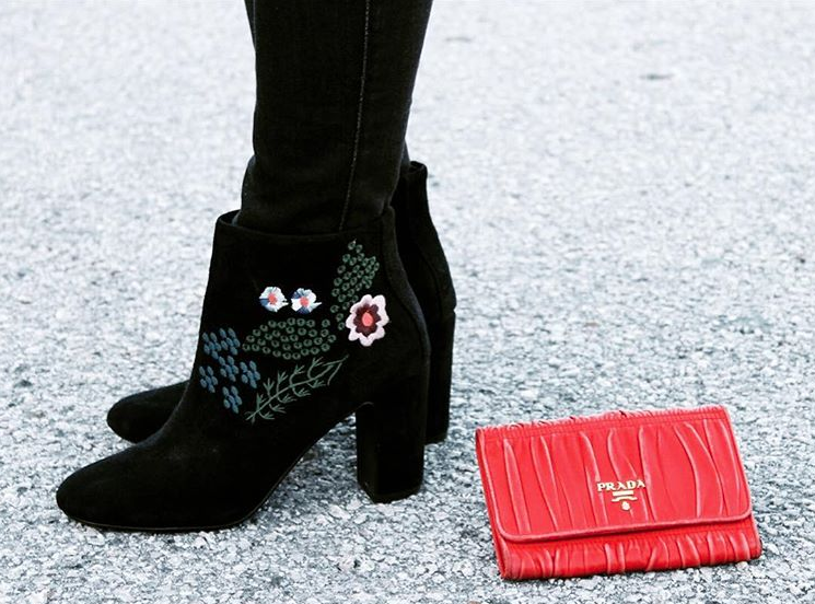 Embroidered bouquet suede boots by  Nanette Lepore . Ruched leather Napa Gaufre wallet by  Prada .