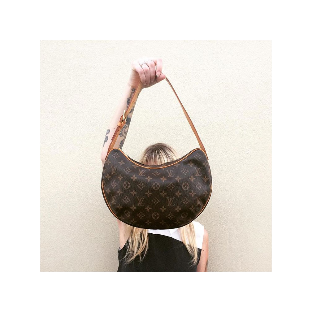 Louis Vuitton  Croissant MM handbag. Silk black and white blouse with collar by  Equipment .