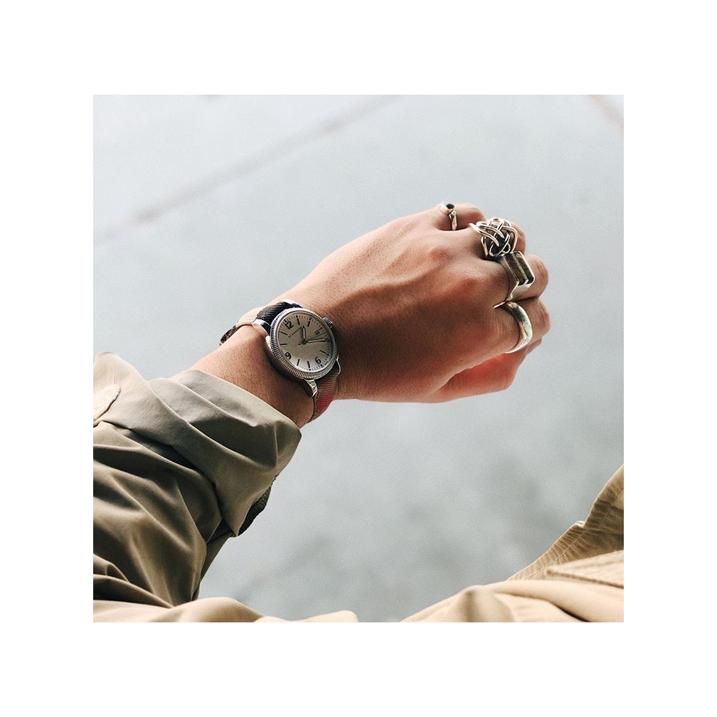 Watch,  Burberry . Rings, model's own.