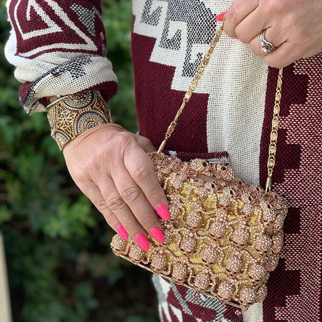 Gorgeous crystal #skull #eveningbag made with #swarovskicrystals in #rosegold for $60. #francescas #cuff #bracelet new $9. #vintage #silverado #southwestern maxi jacket size m $20. All at our college park location