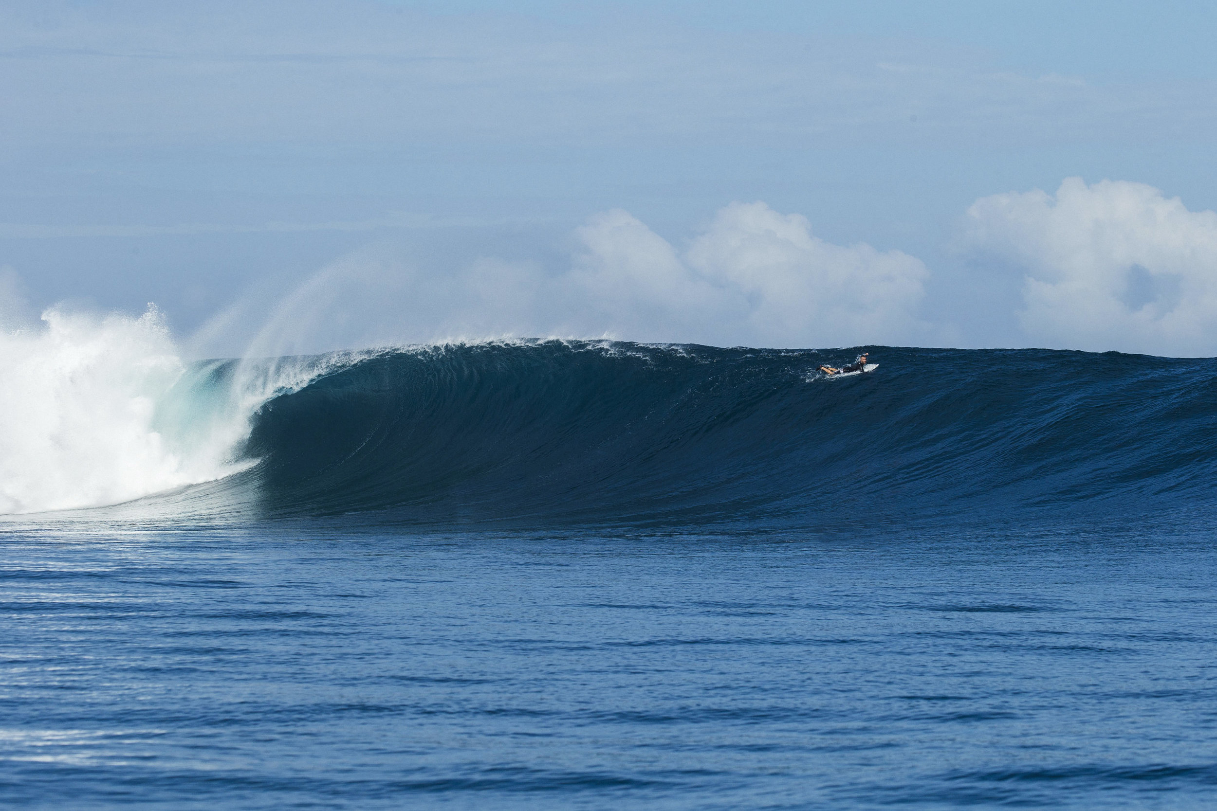 super chef Pete evans paddling over a giant cloudbreak wave in Fiji