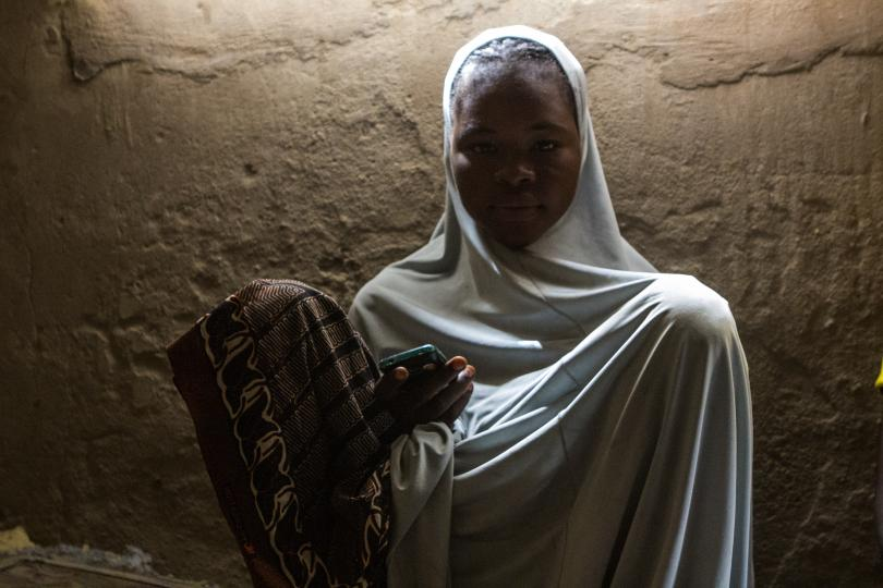 A woman poses for a photo while waiting for a call on her mobile phone in Yola, Nigeria on March 9 2015. In many parts of sub-Saharan Africa people are more likely to own a cell phone than any other electronic device. This could be the key to economic development in the next five years.   Photo: Kathleen Caudlerwood