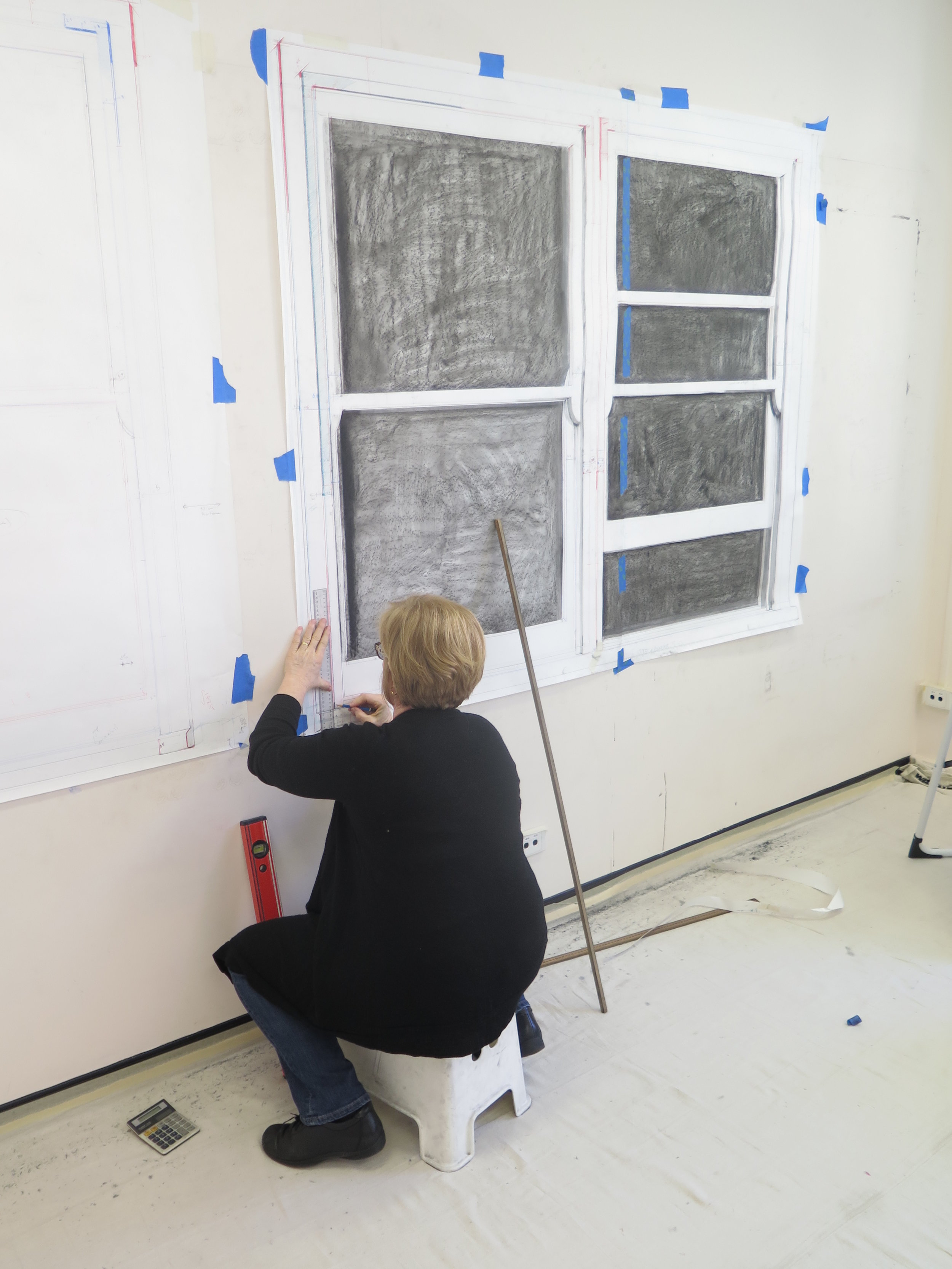 Catherine O'Donnell working in her studio on  Inhabited Space  drawing installation,Image courtesy of the artist