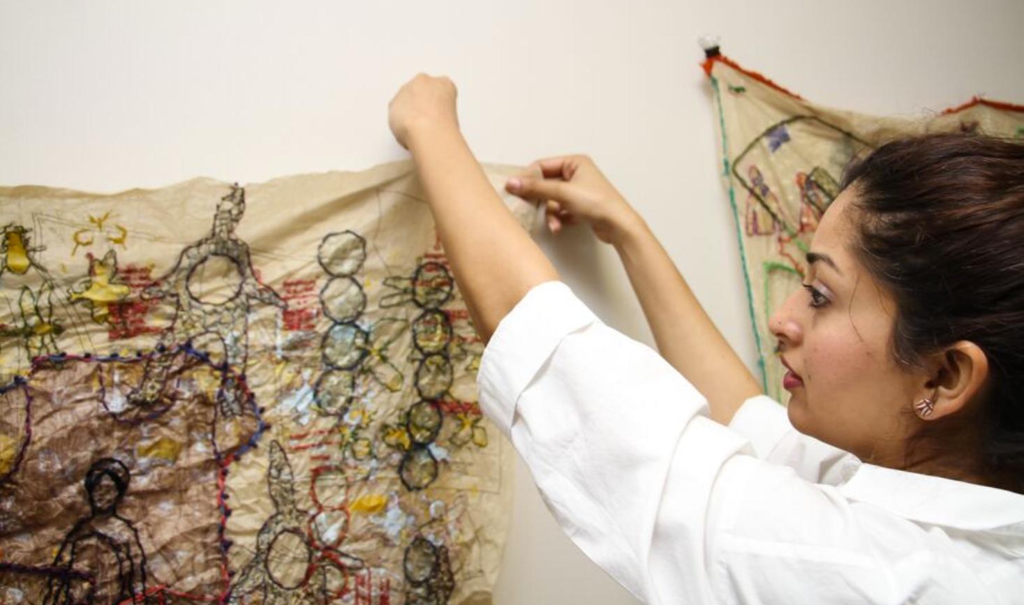 Mehwish Iqbal installing work.Image courtesy of the artist