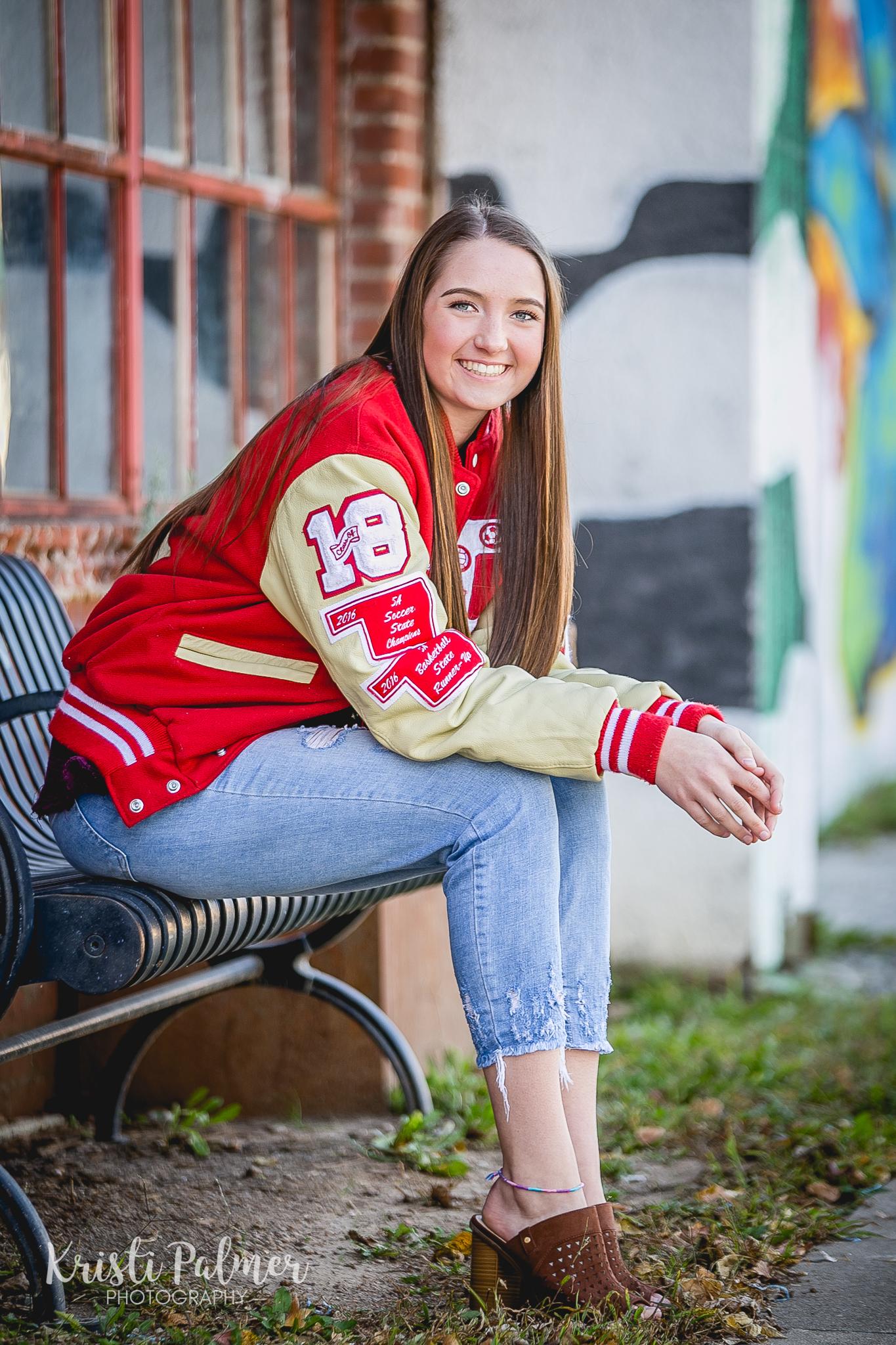 senior girl photo in letter jacket