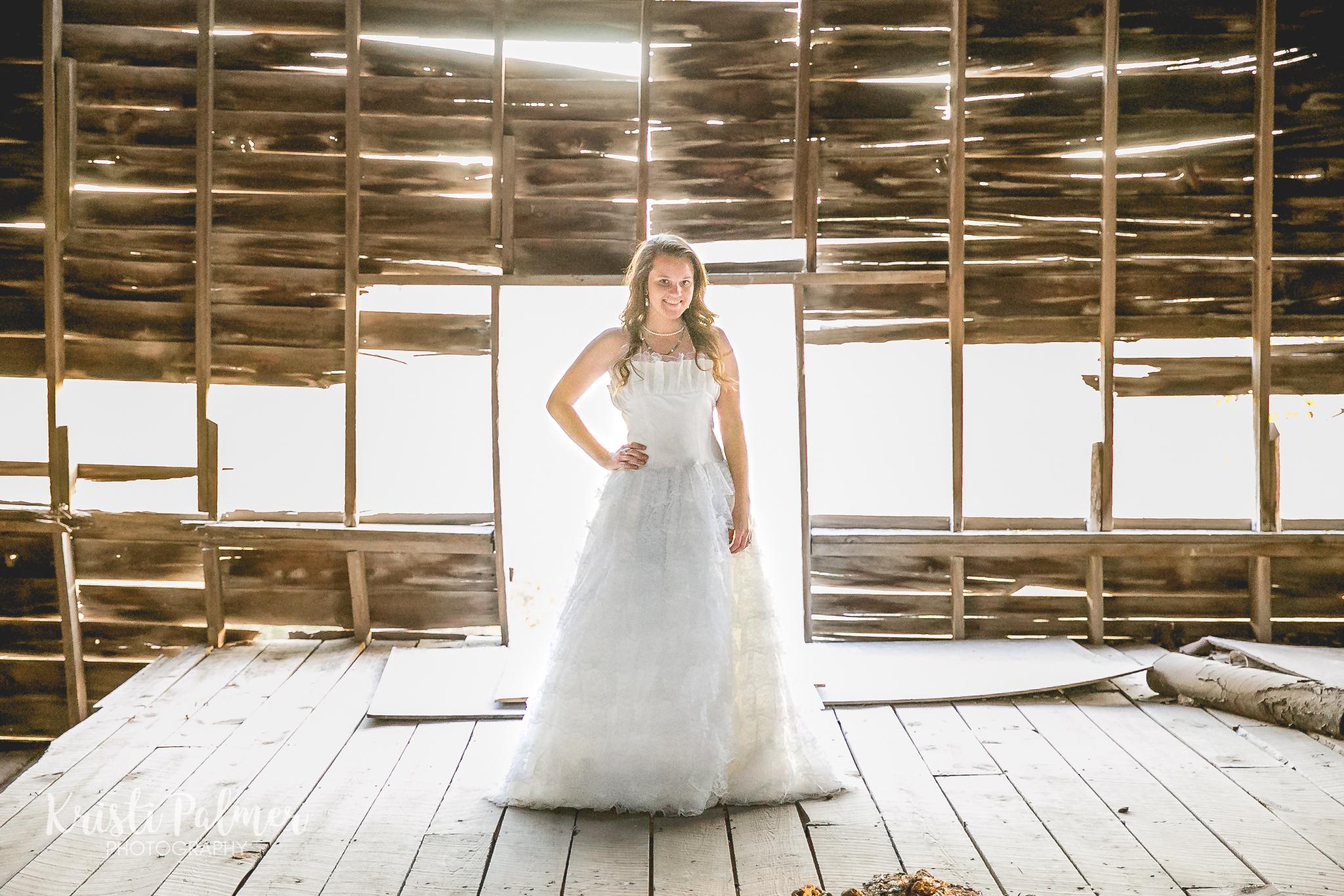 teen senior girl in fancy dress in old barn