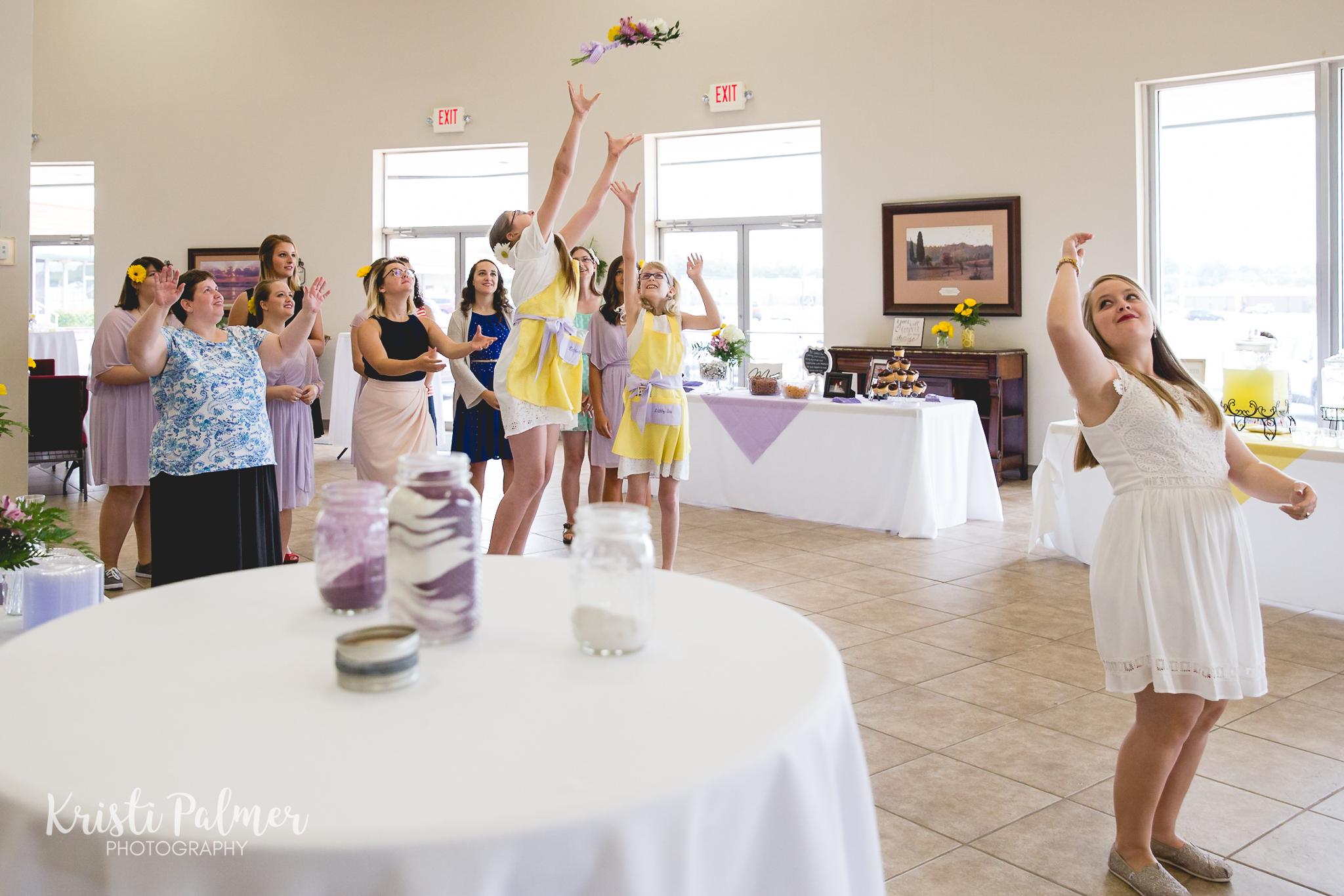 wedding reception bride throwing the bouquet