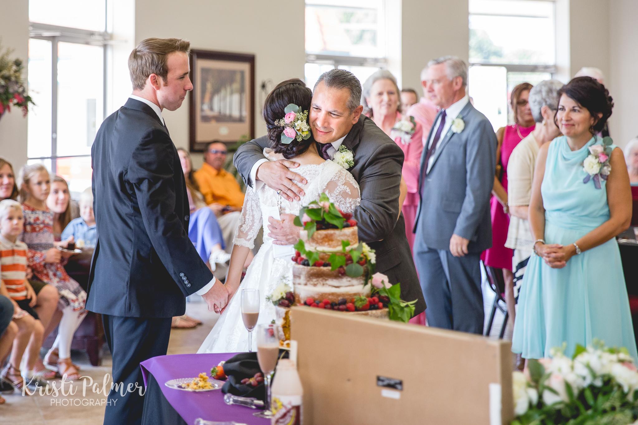 wedding reception cake and hugs