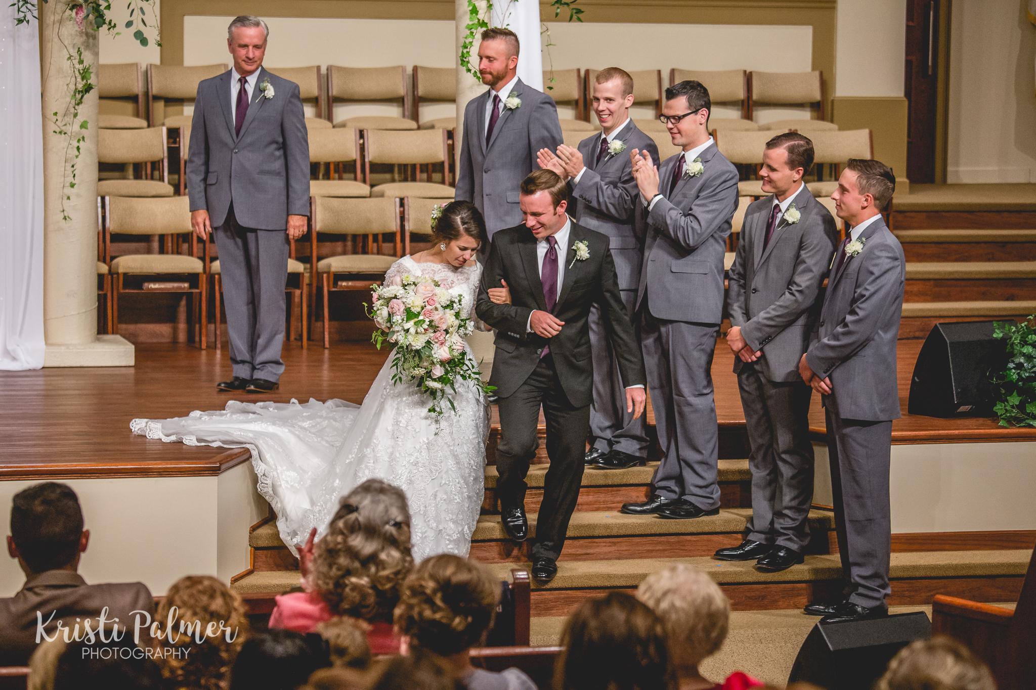 wedding ceremony bride and groom wedding party