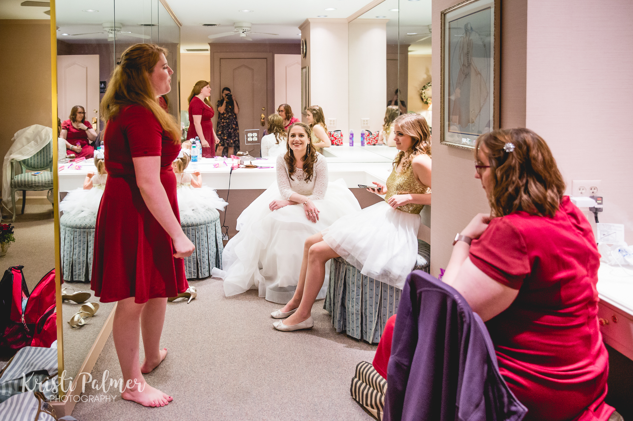 bride and bridesmaids getting ready for the wedding