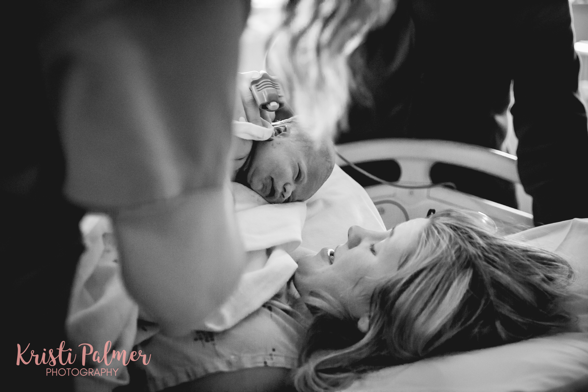 mom with new baby after delivery birth