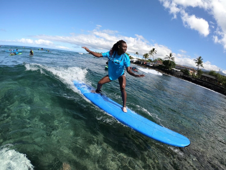 Surfer at Kahalu'u Bay, courtesy of Kona Town Surf Adventures