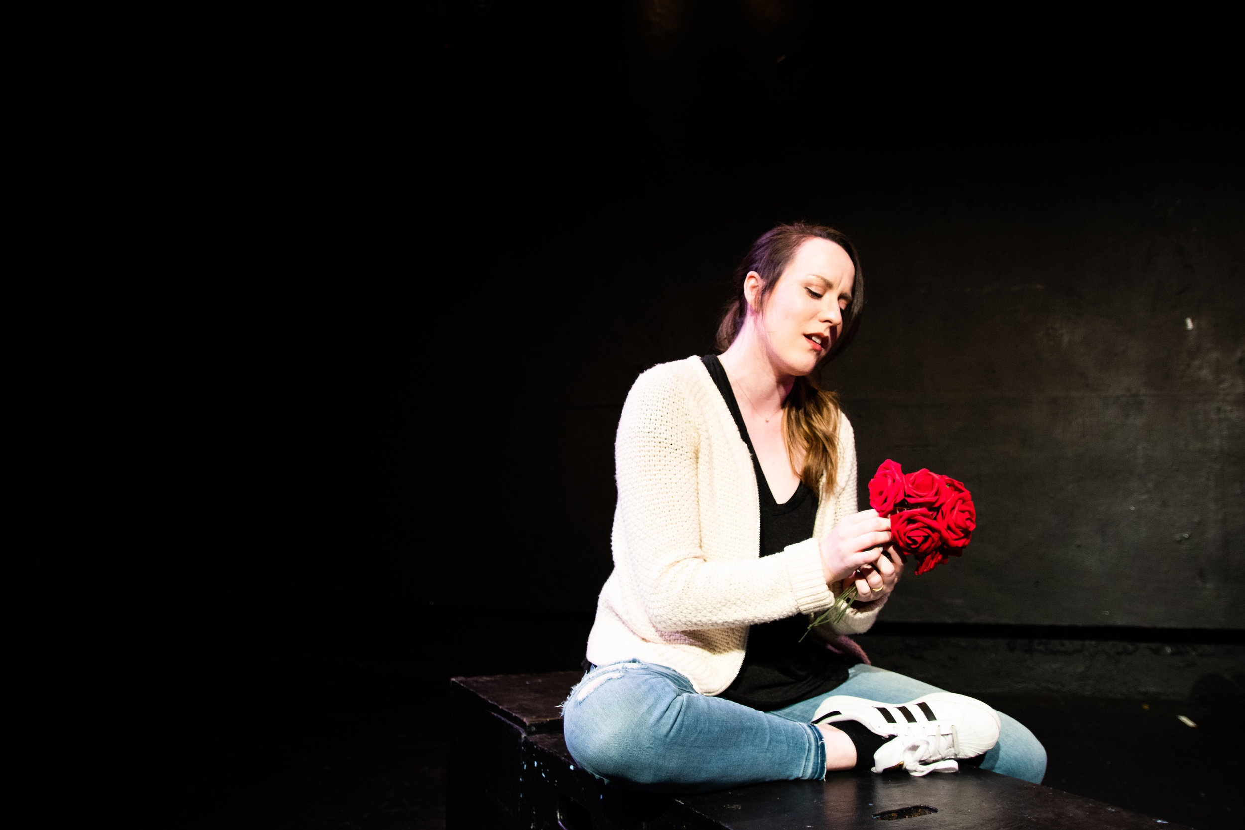 A Woman With A Rose - The Secret Theatre