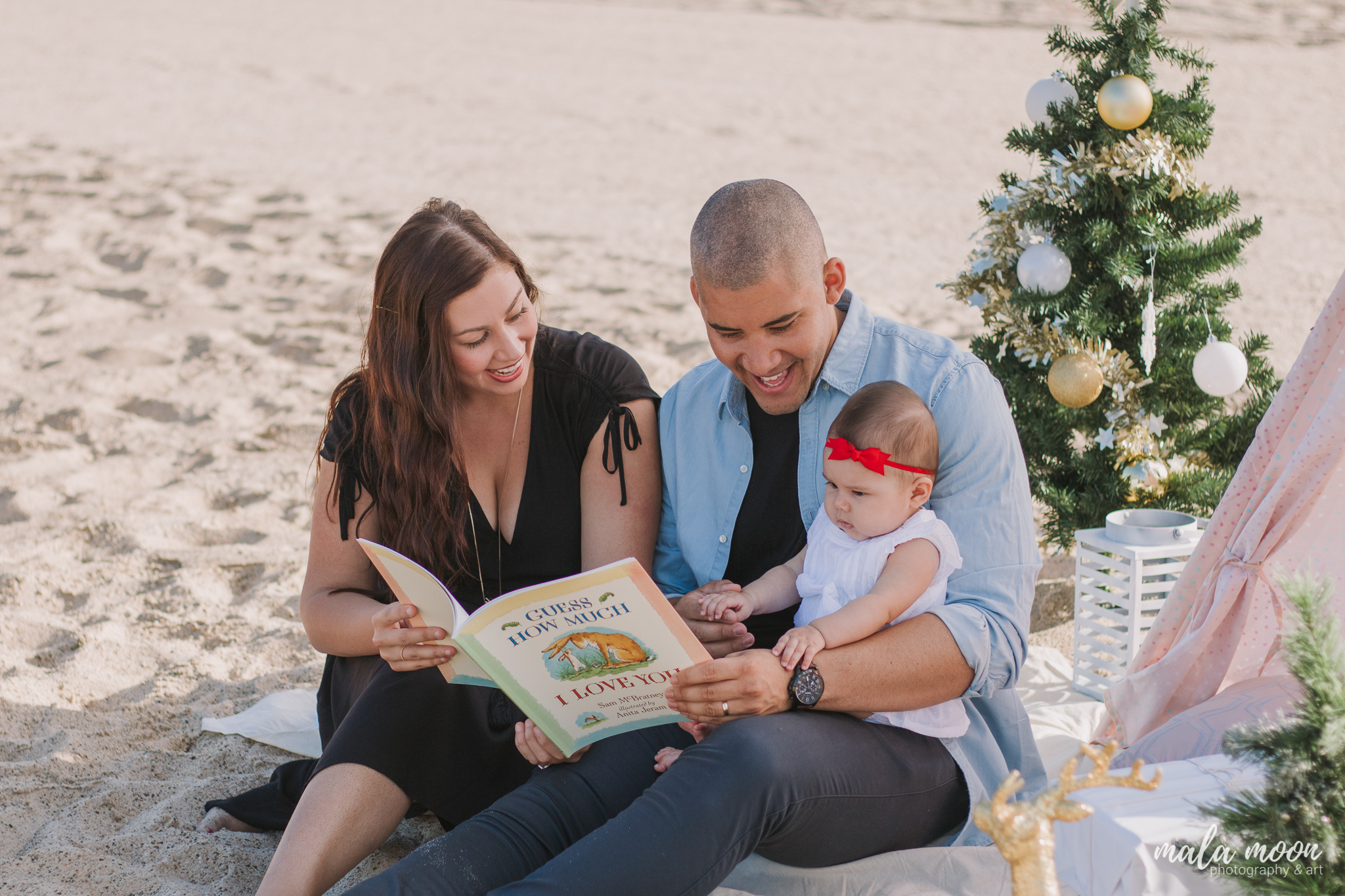 family-reading-beach