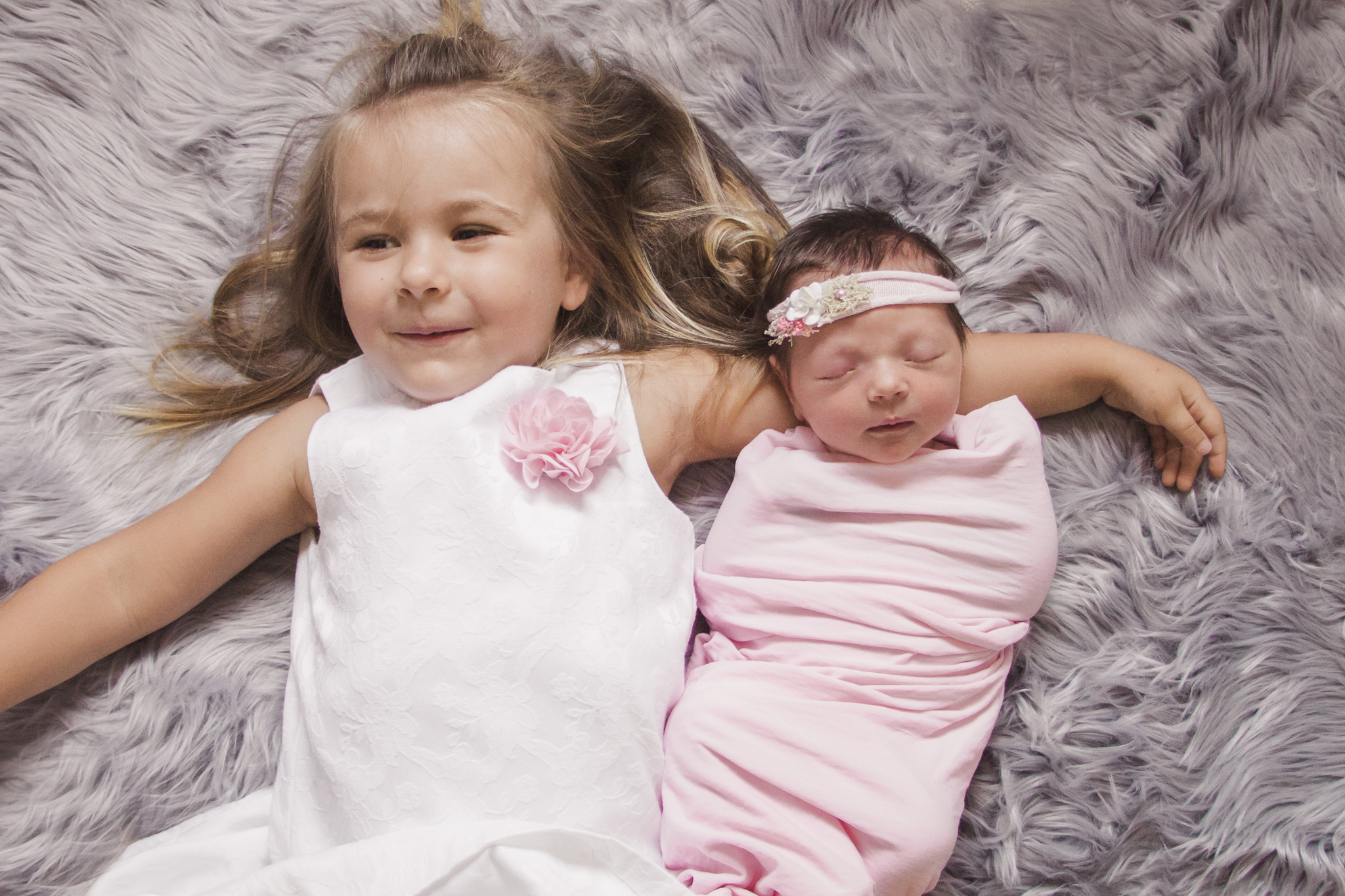 newborn with sister