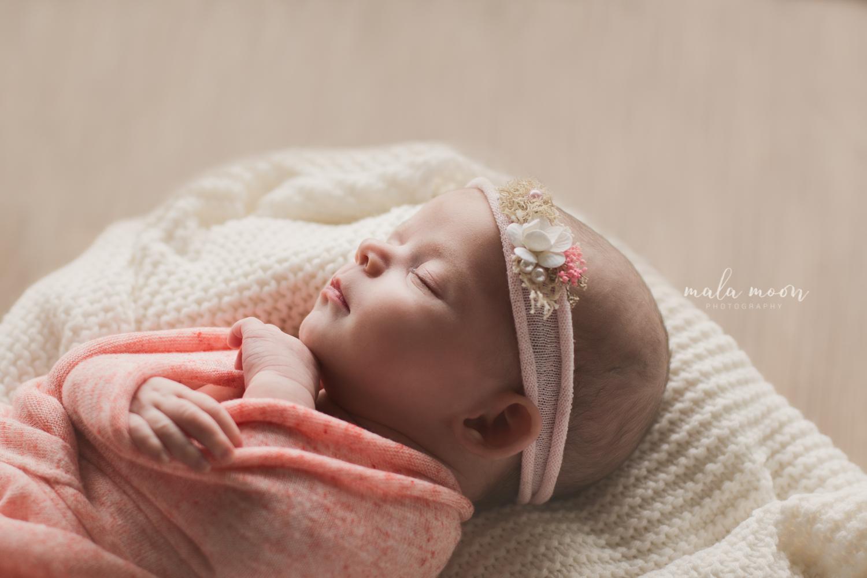 side-profile-portrait-of-cute-newborn