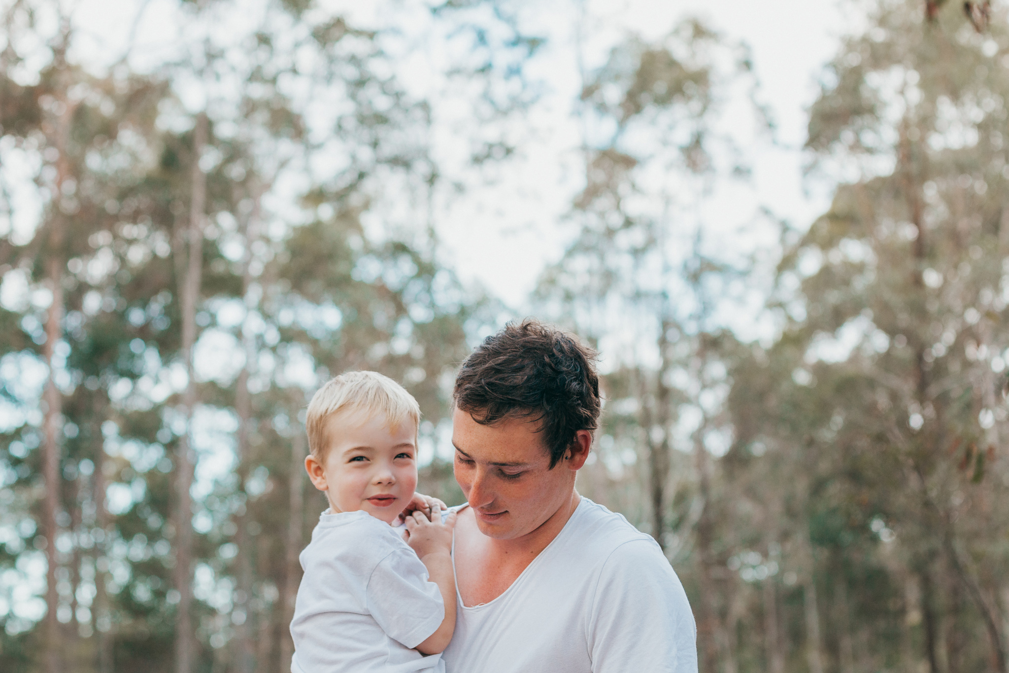 father-holding-son-outdoors-for-portrait