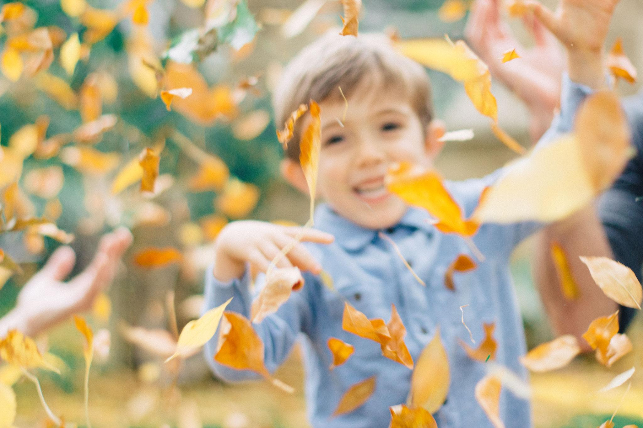 kid-throw-leaves.jpg