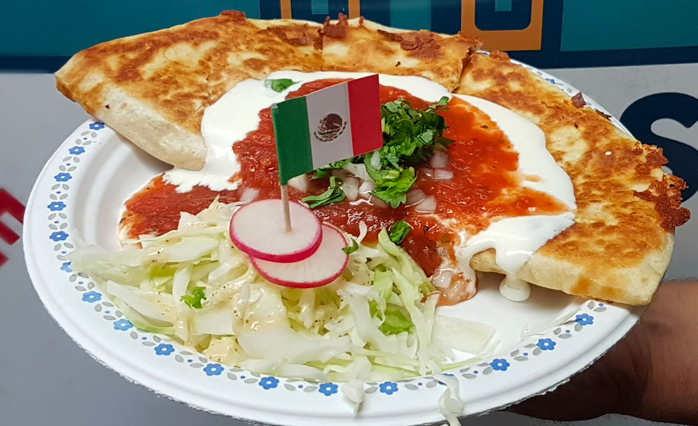 Quesadilla - Our quesadillas are filled with melted cheese & our marinated meats then crisped to perfection on the grill. We top them with Mexican cream, fresh salsa, cilantro & onions.