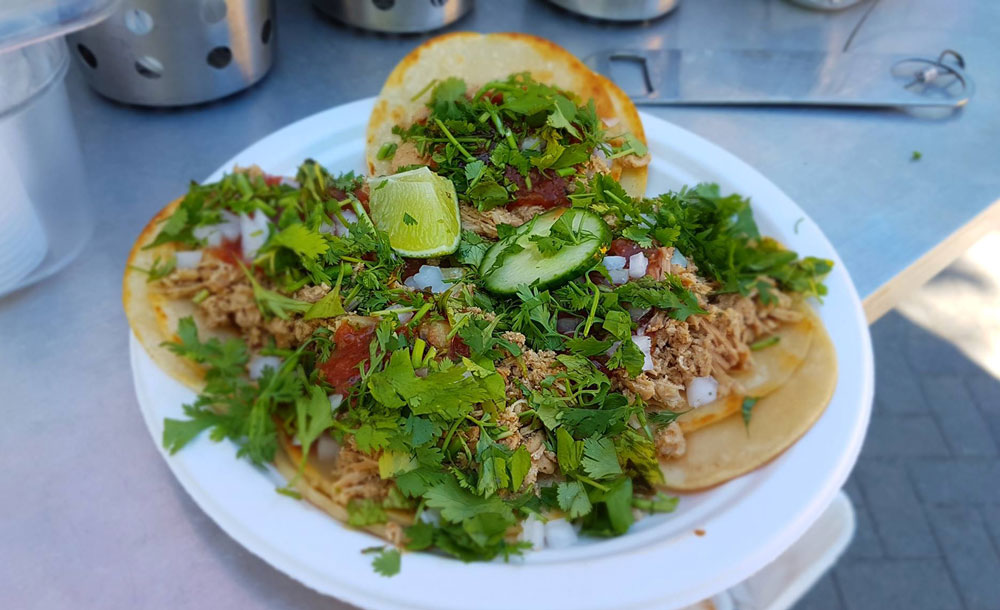 Tacos - Our tacos are served on locally made corn tortillas. We fill them with our slow cooked marinated meats and top them with fresh housemade salsa, fresh cilantro & white onions. A truly authentic experience.