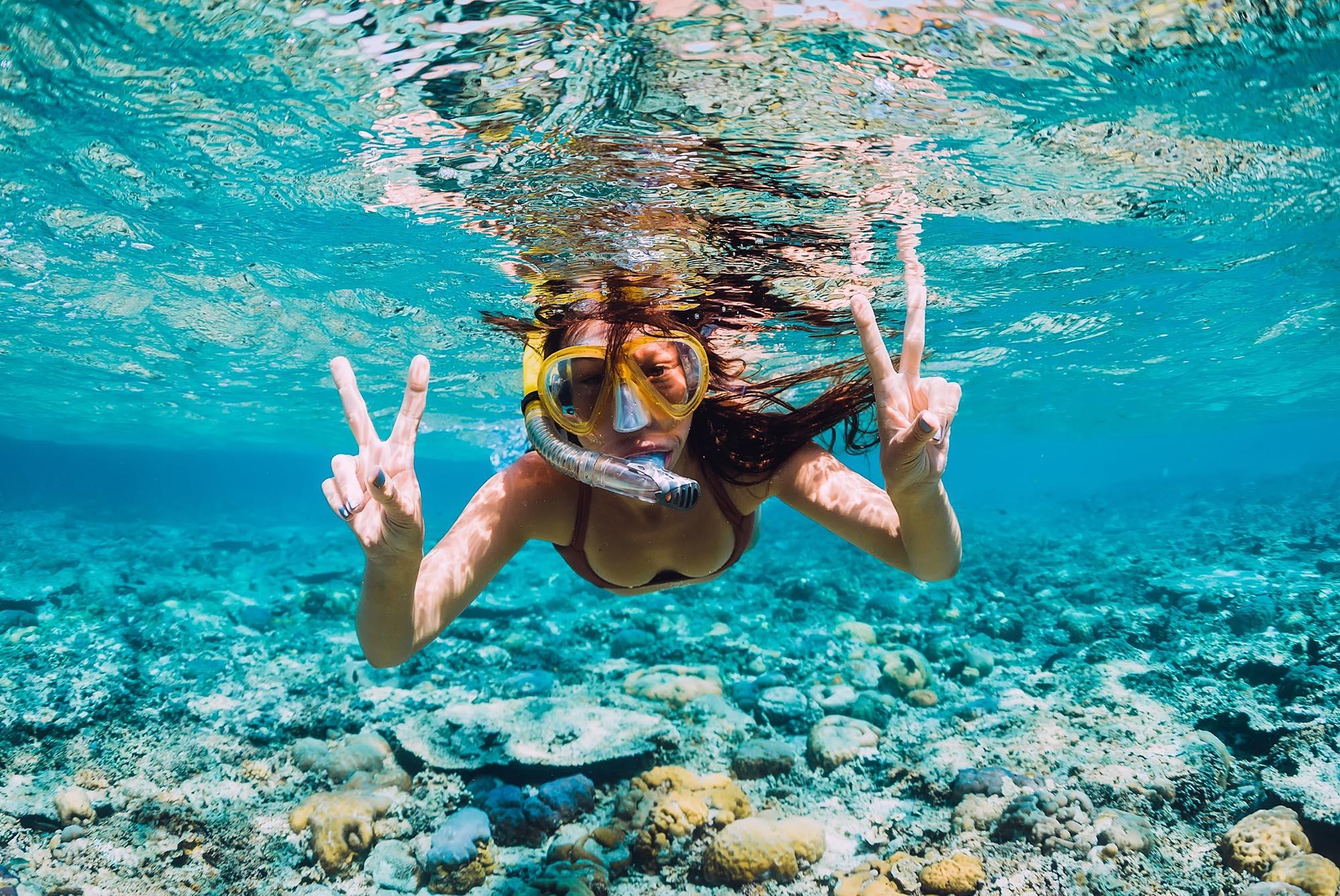 Girl snorkelling in reef.jpg