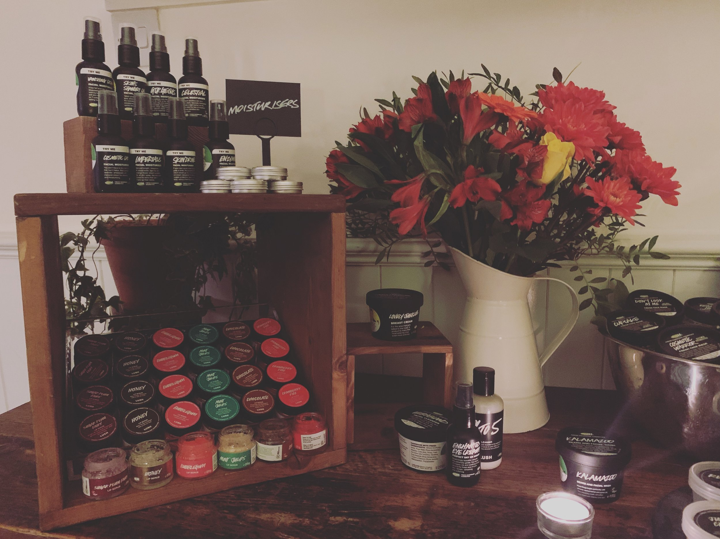 A photo of Lush products safe for pregnant women and a jug of bright flowers