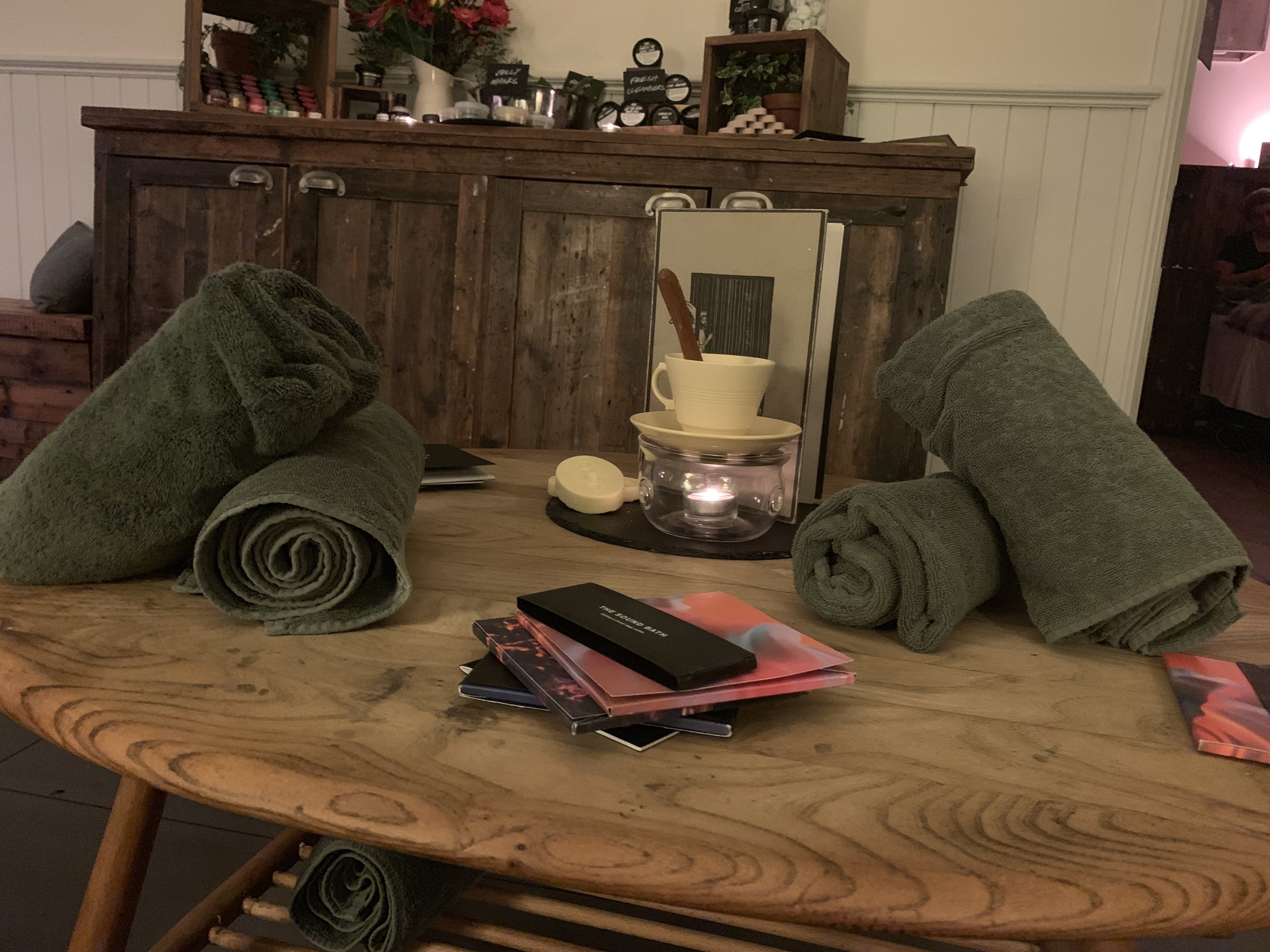 An image of Lush pregnancy products, towels and a candle at the spa