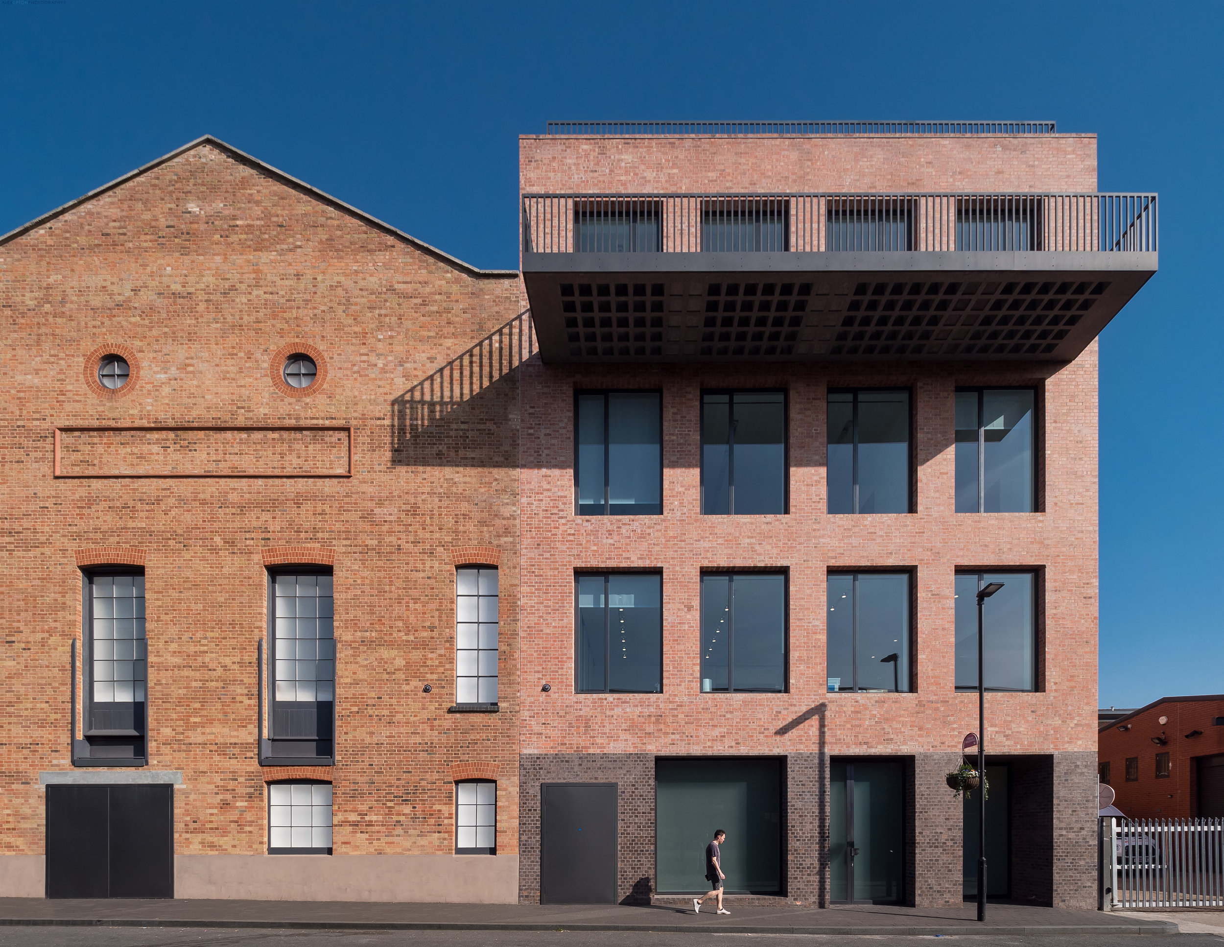 A sense of architectural scale - contrasting the former industrial warehouse with the galleries new office space.
