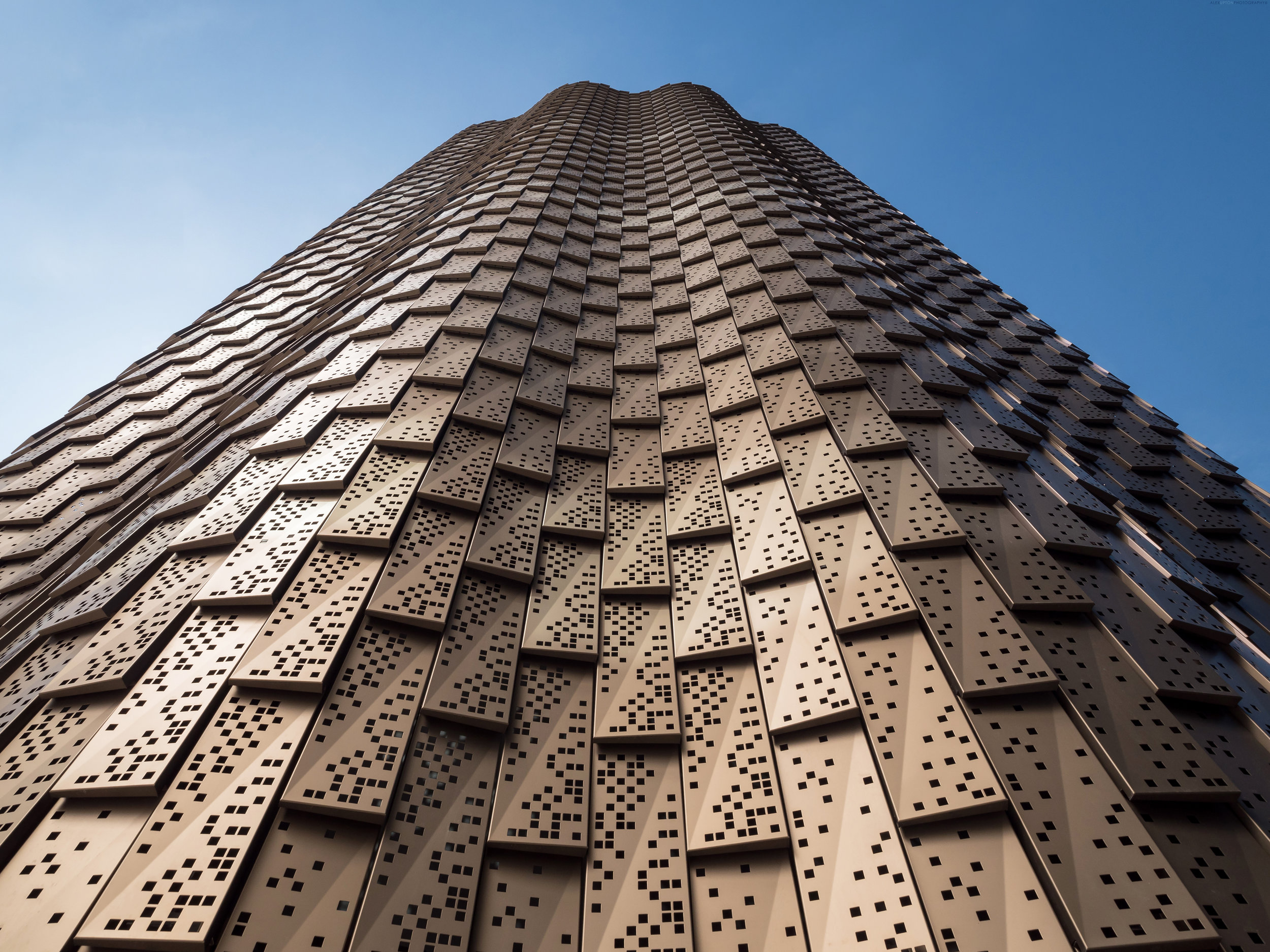 Thousands of perforated aluminium panels cover the facade.