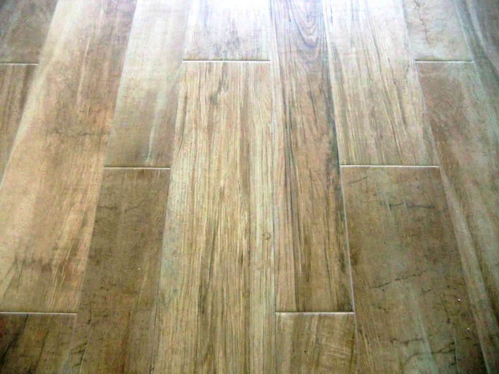driftwood porcelain tile flooring home remodeling at Ocean Reef Club, Key Largo 33040 by Marcus Mars Interiors