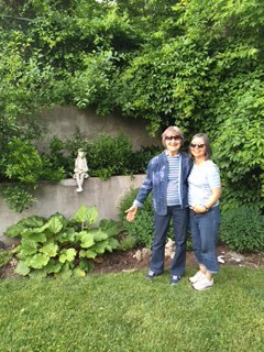 Pat and Denise admire the garden fairy.