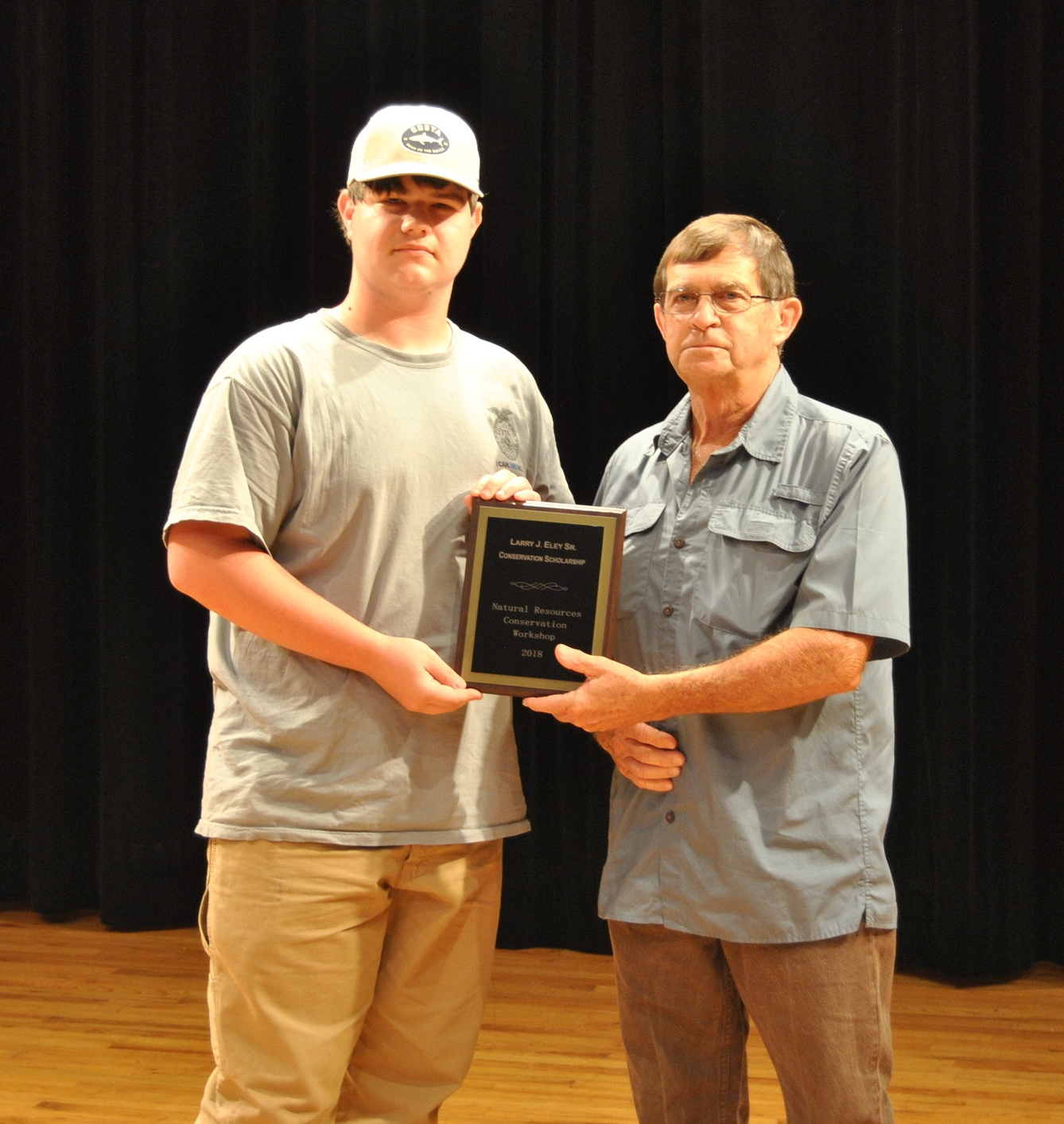 The winner of the first ever $1,500 Larry J. Eley Sr. Memorial Scholarship is Matthew Roberts! Matthew is a rising senior at  Putnam County High School . Pictured with Matthew is Piedmont Soil & Water Conservation District Chairman Pat Hardy.