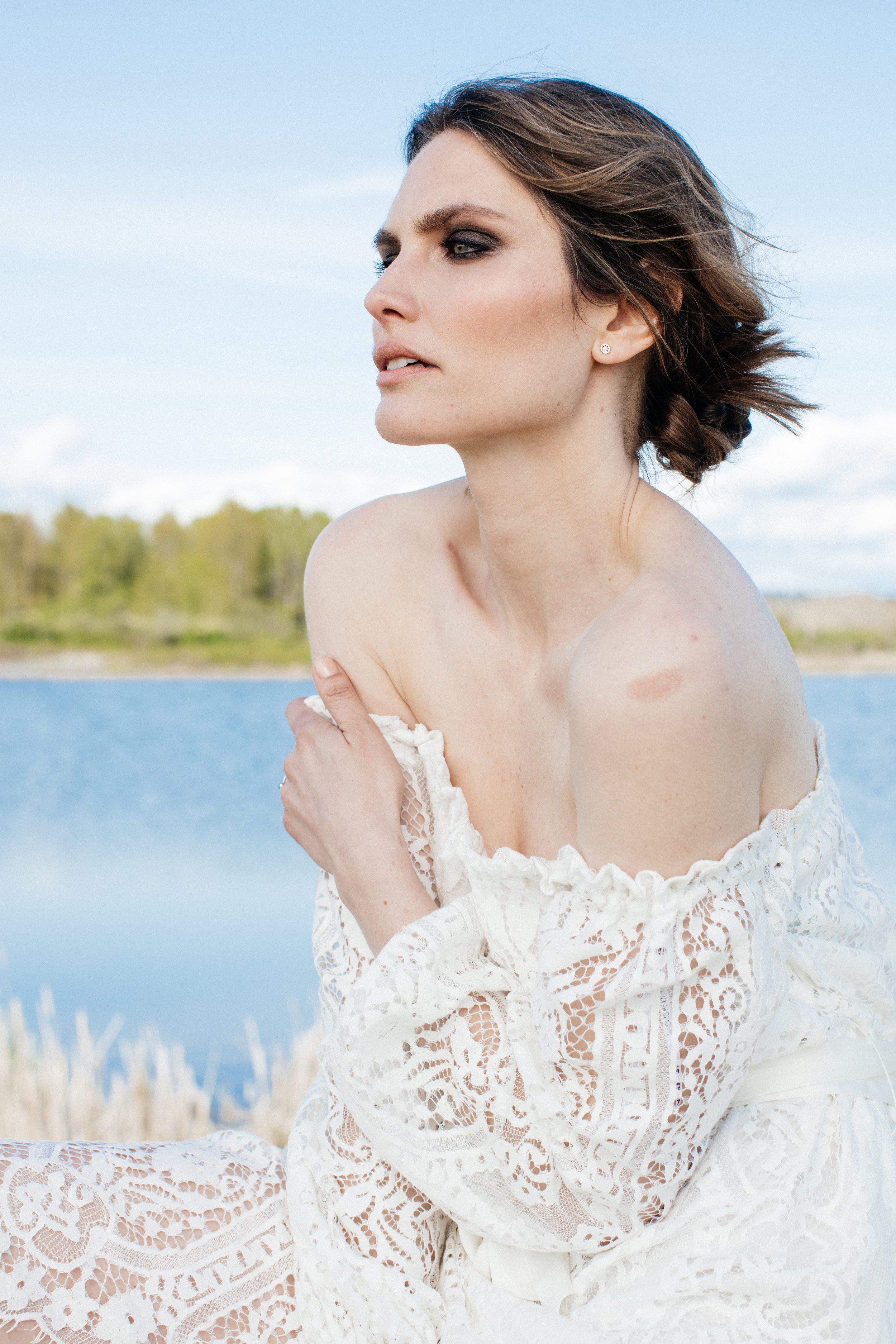 Model Kristy McQuade wearing a white lace dress on a editorial fashion photoshoot.