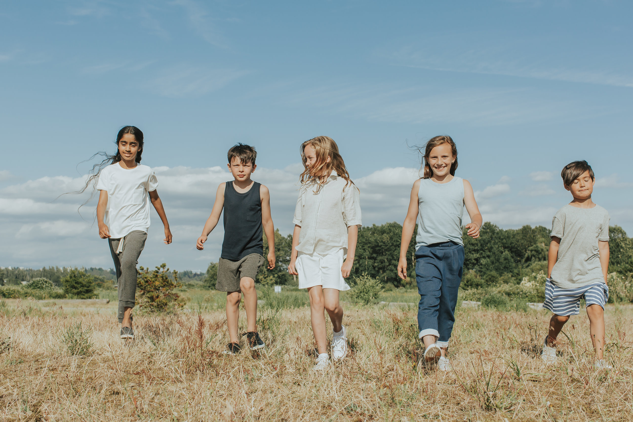 Kids walking in field.