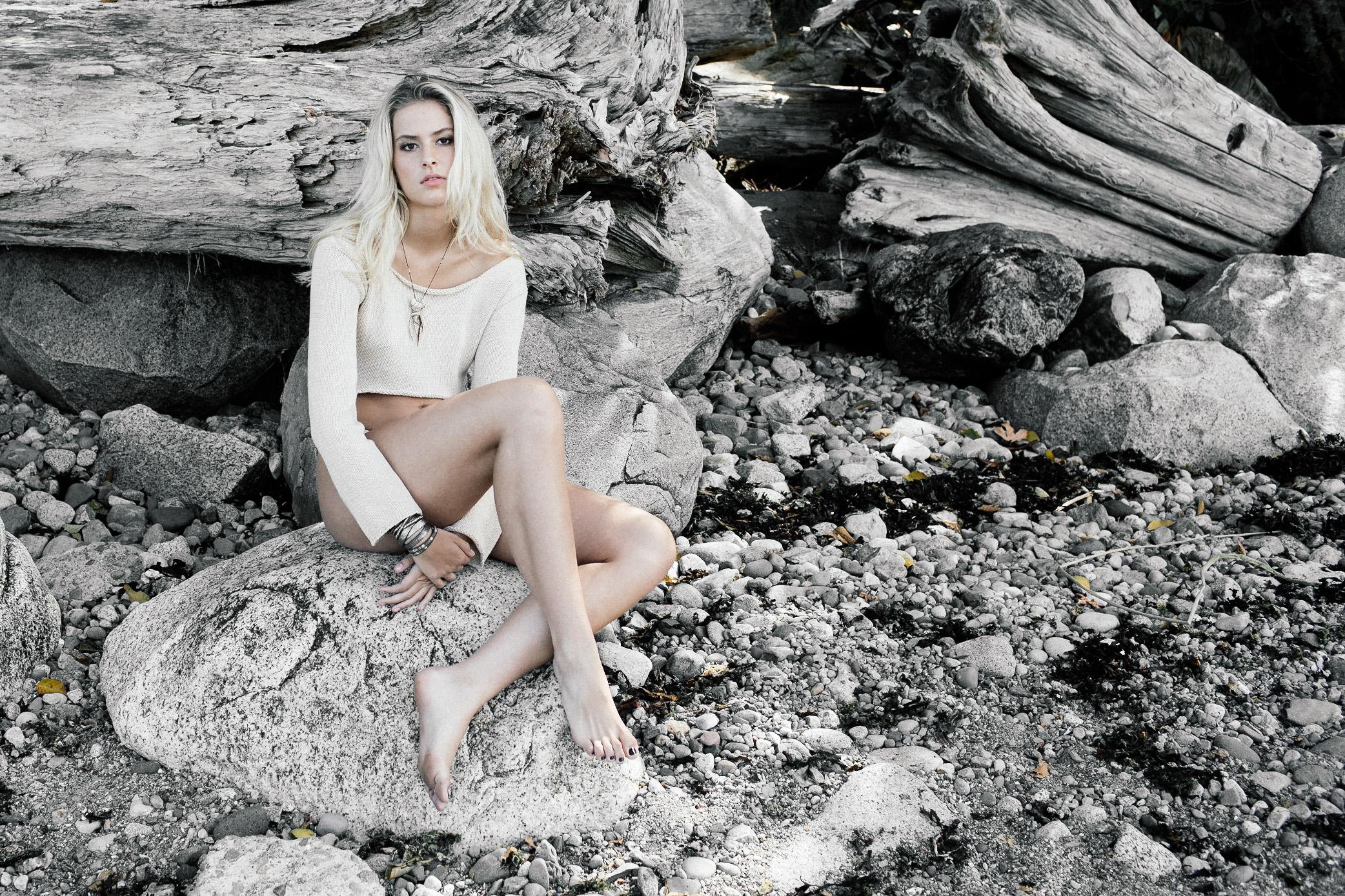 A beach editorial image of Corinne Isherwood.