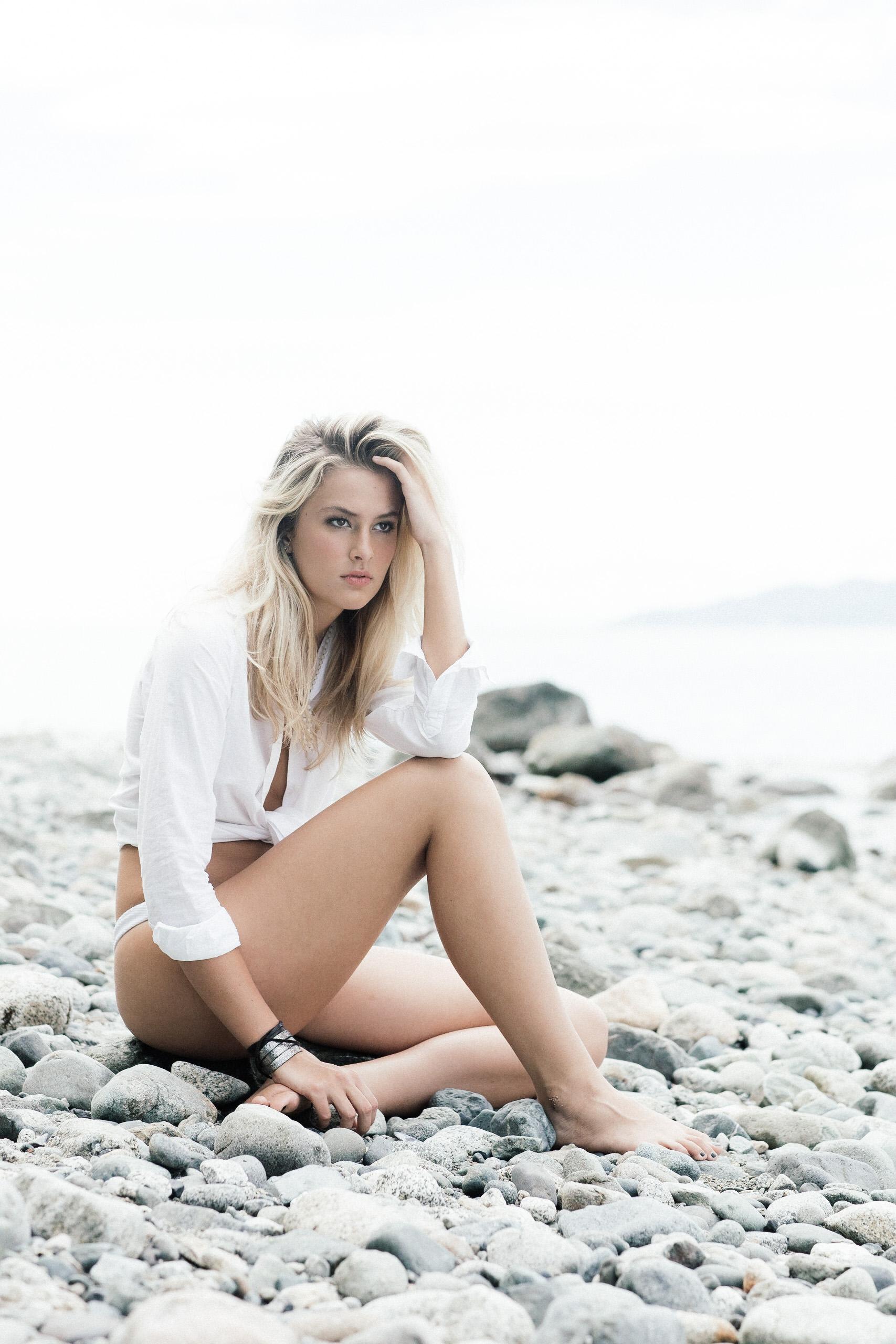 A beach editorial photo of Corinne Isherwood.