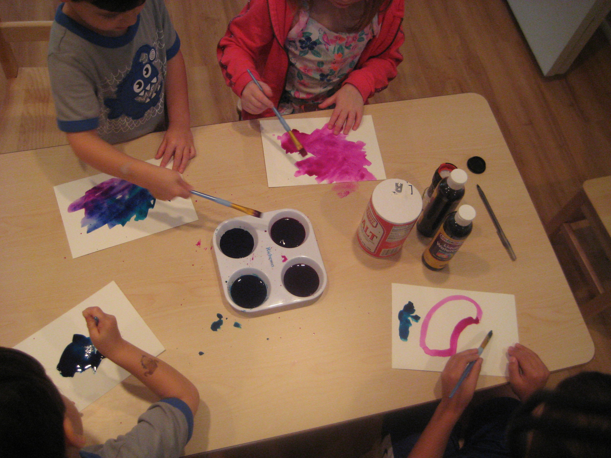 Exploring colors while creating salt paintings.