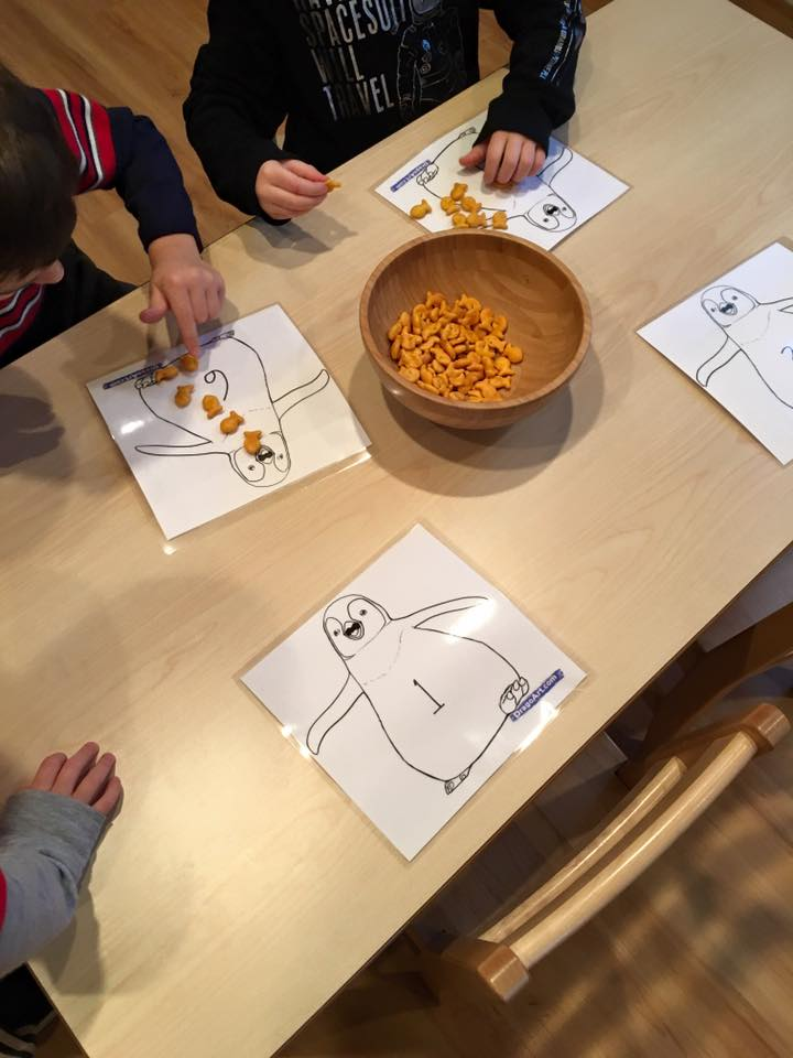 Practicing 1:1 correspondence with penguins and their favorite food, which also happens to be our favorite too!