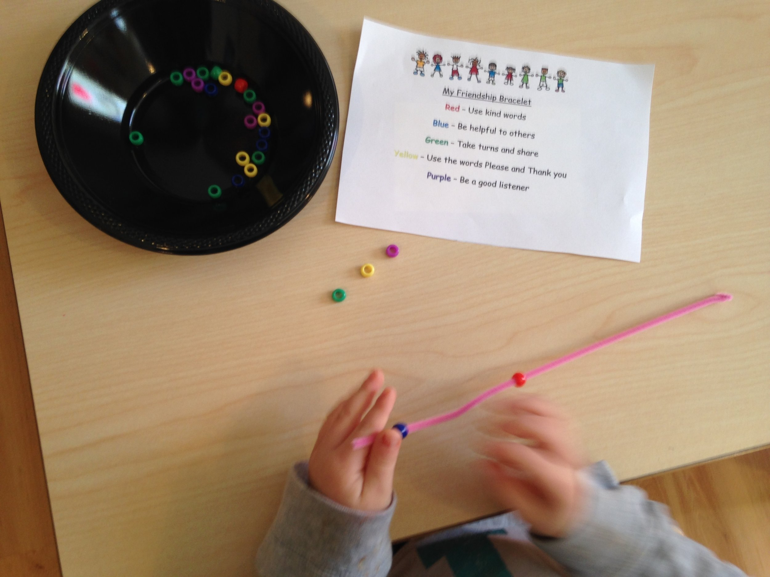 Creating a friendship bracelet to help us remember our friendship rules