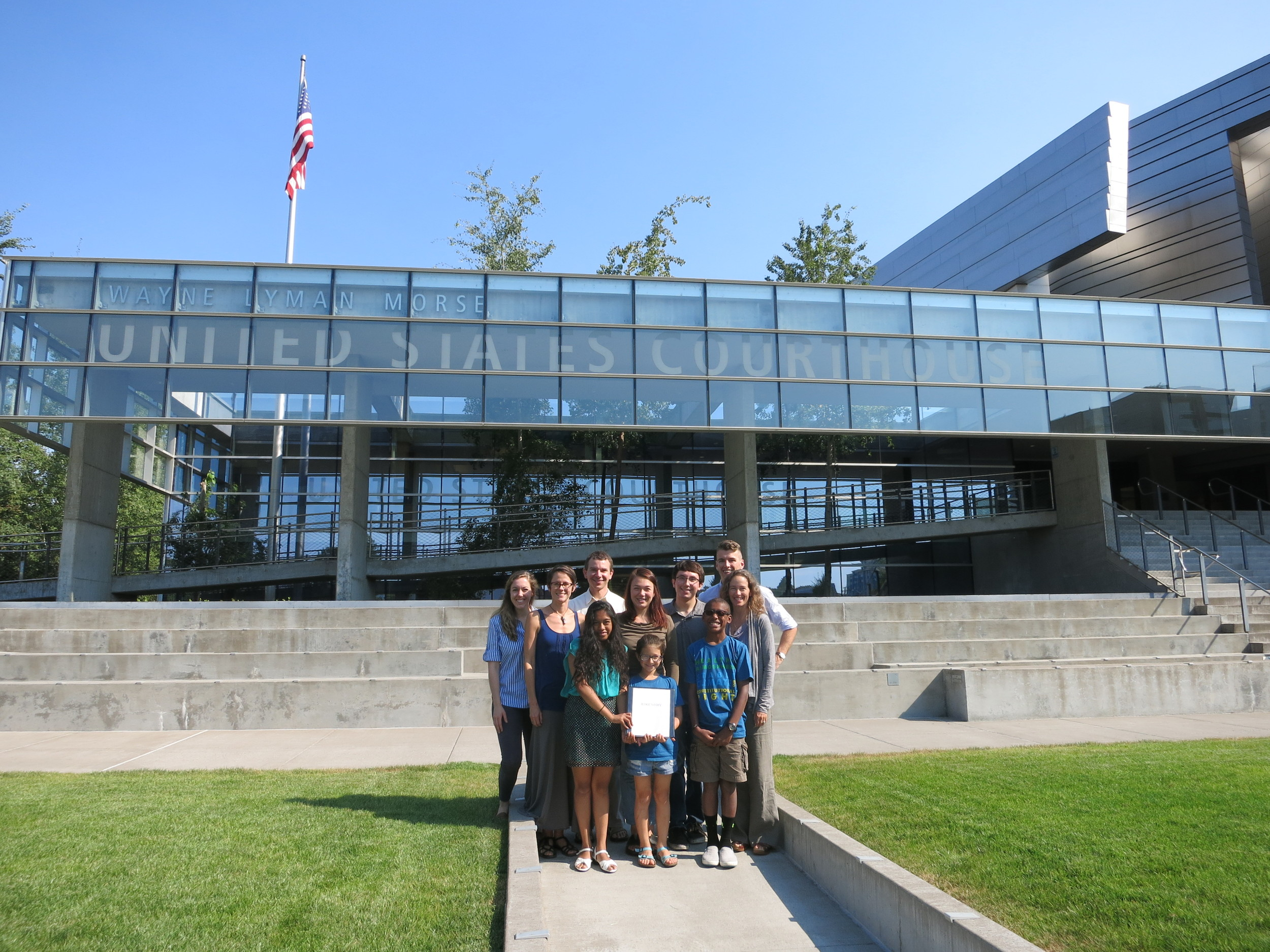 Some of the plaintiffs and OCT staff and law clerks outside the Wayne Morse United States Courthouse in Eugene, OR on August 12, just before submitting the federal complaint.