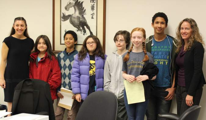 Andrea Rodgers (far left) and Julia Olson (far right) with six of the Washington youth plaintiffs.