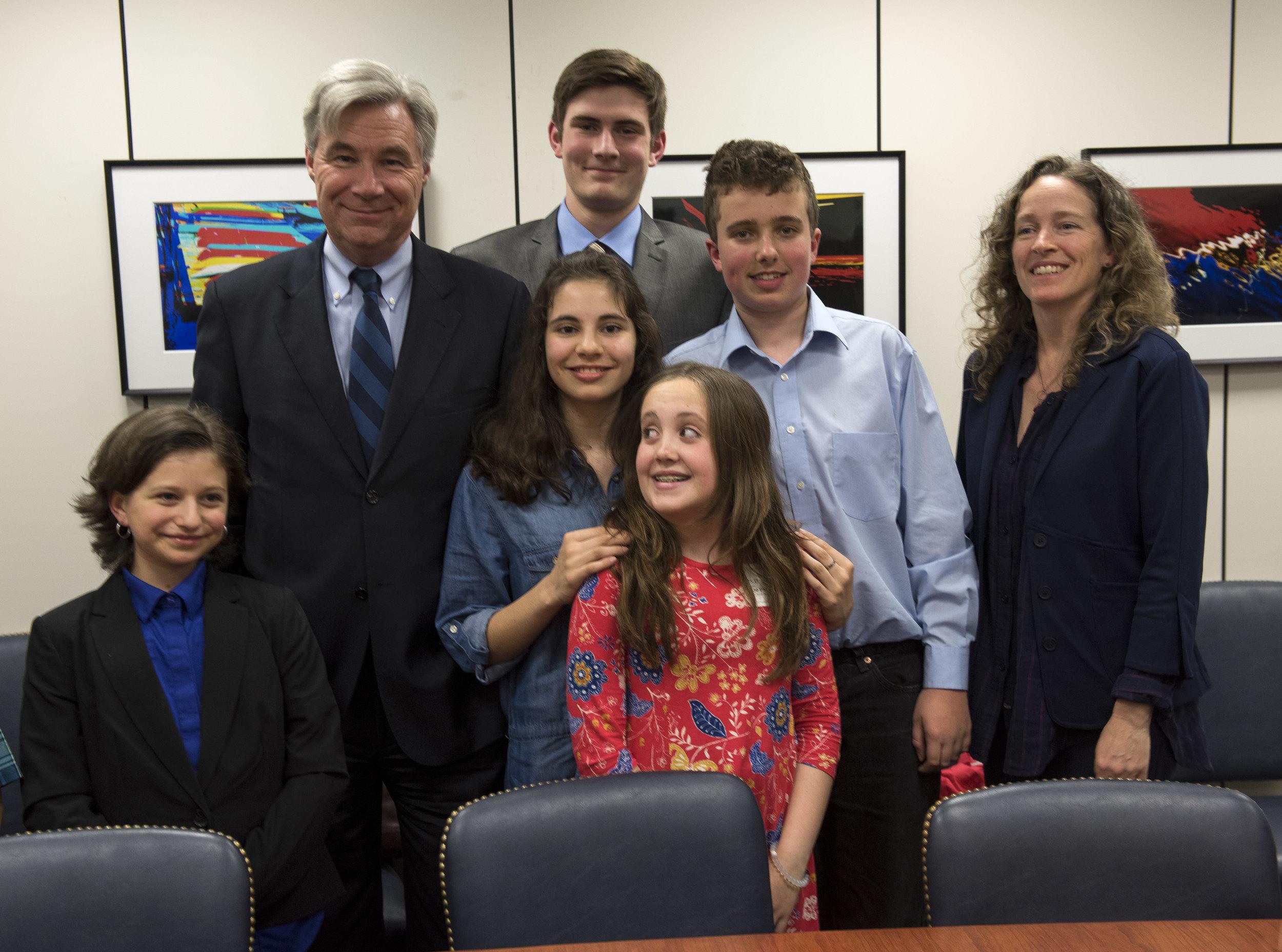 Nathan with Senator Sheldon Whitehouse, fellow #youthvgov plaintiffs and co-lead counsel Julia Olson on Capitol Hill, April 2017. Photo: Robin Loznak